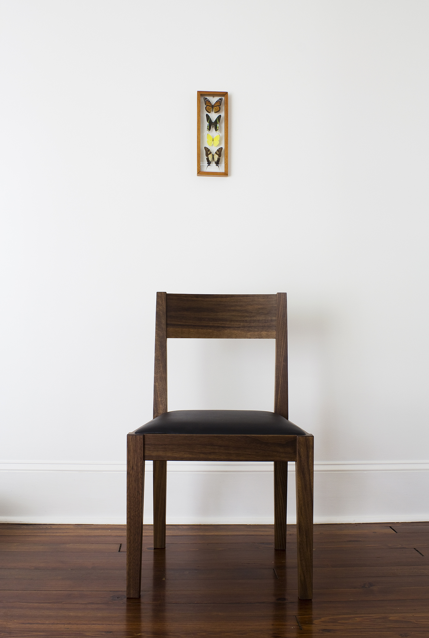 Jetmore dining chair in walnut and black leather