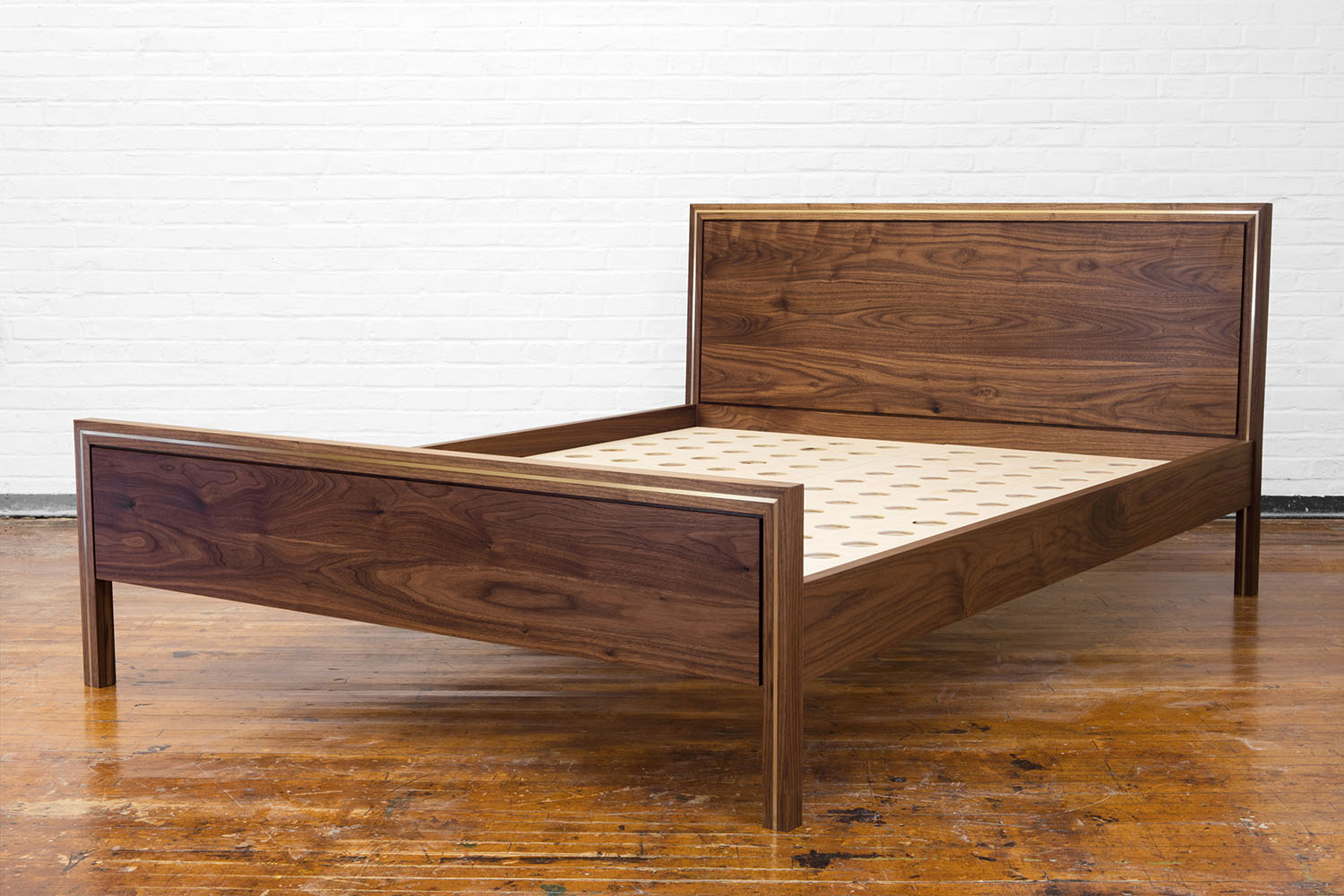 3/4 view of the Hudson bed in walnut with brass