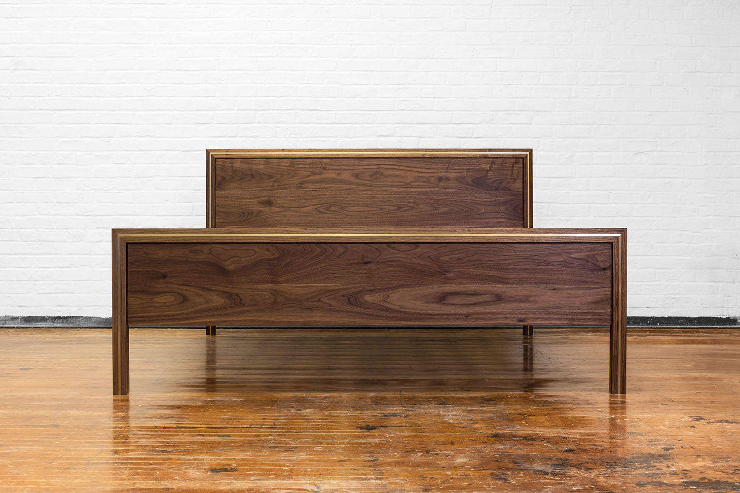 Front view of the Hudson bed in walnut with brass