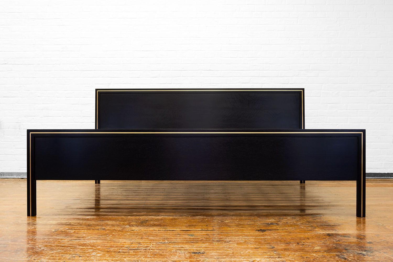 Front view of the Hudson Bed in ebonized walnut and brass