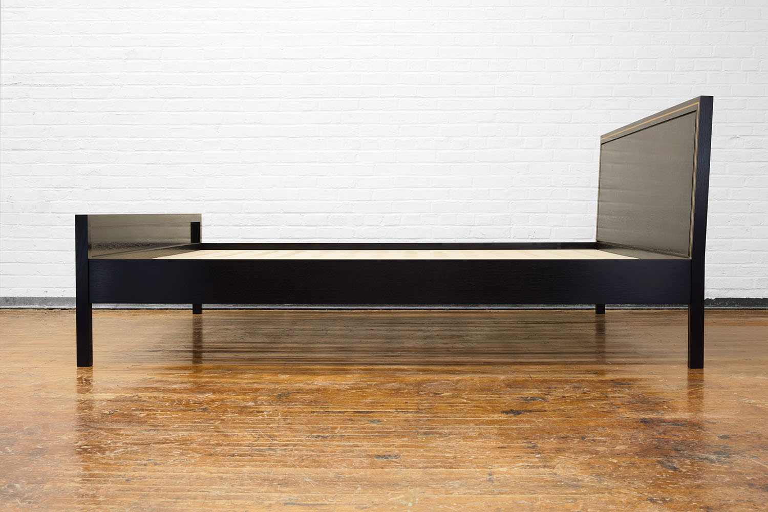 Side view of the Hudson Bed in ebonized walnut and brass