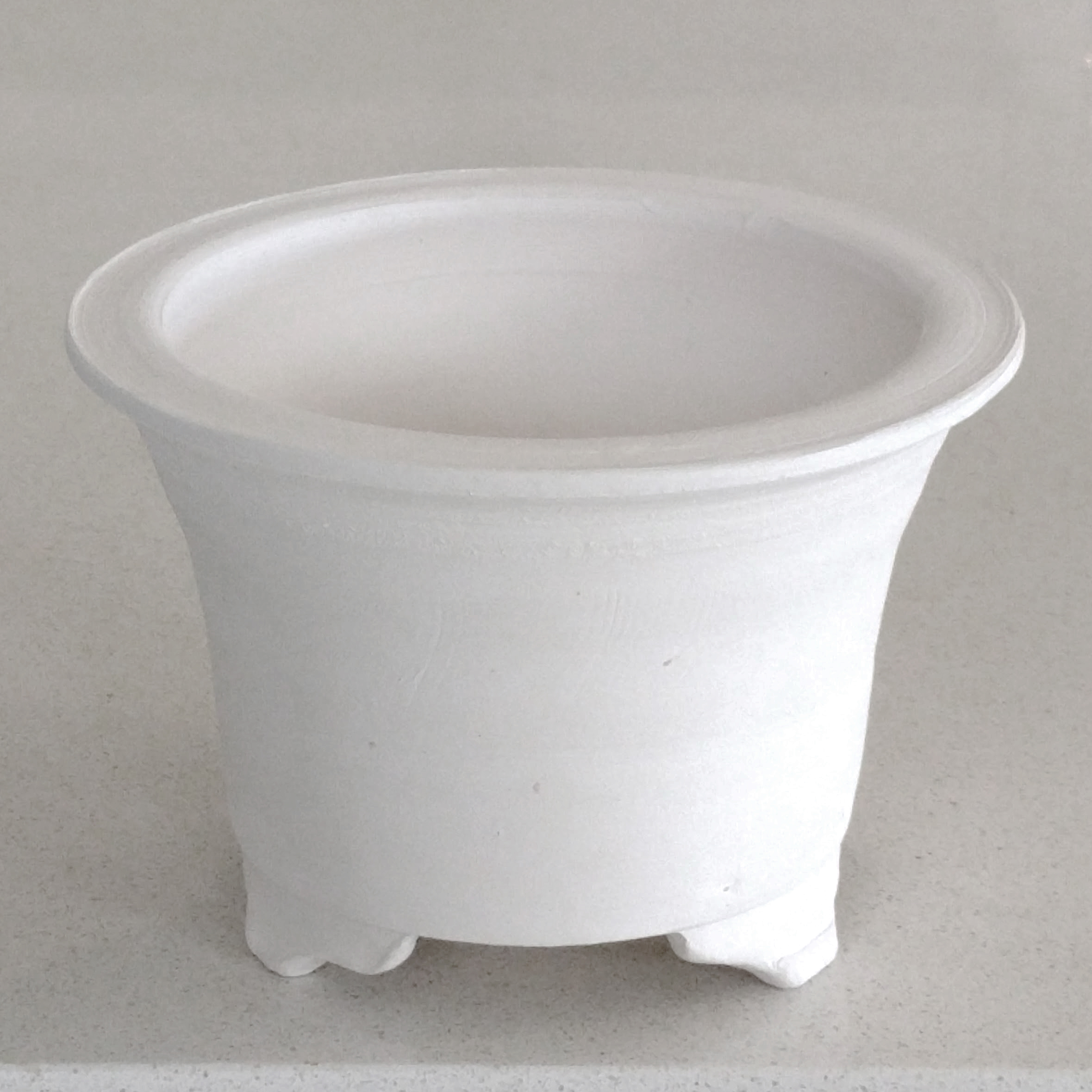 """My """"blank canvas"""" is made of white stoneware clay fired to 1000°C."""