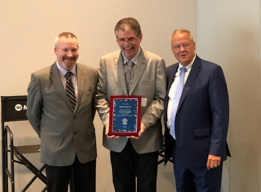 Vice President Gordon Sullivan, President Steve Yaciuk, and Mike White from McNeil & Co. Recognizing McNeil & Company's involvement and support of Believe 31's efforts to promote cancer awareness and prevention in the fire service.  Photo courtesy of ESIP.