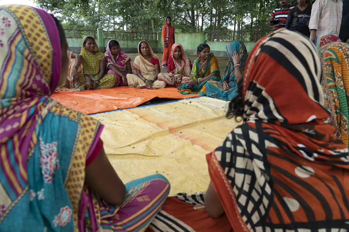 Sulochana talks with other women during a group meeting here in Uday Nagar village, Bihar.