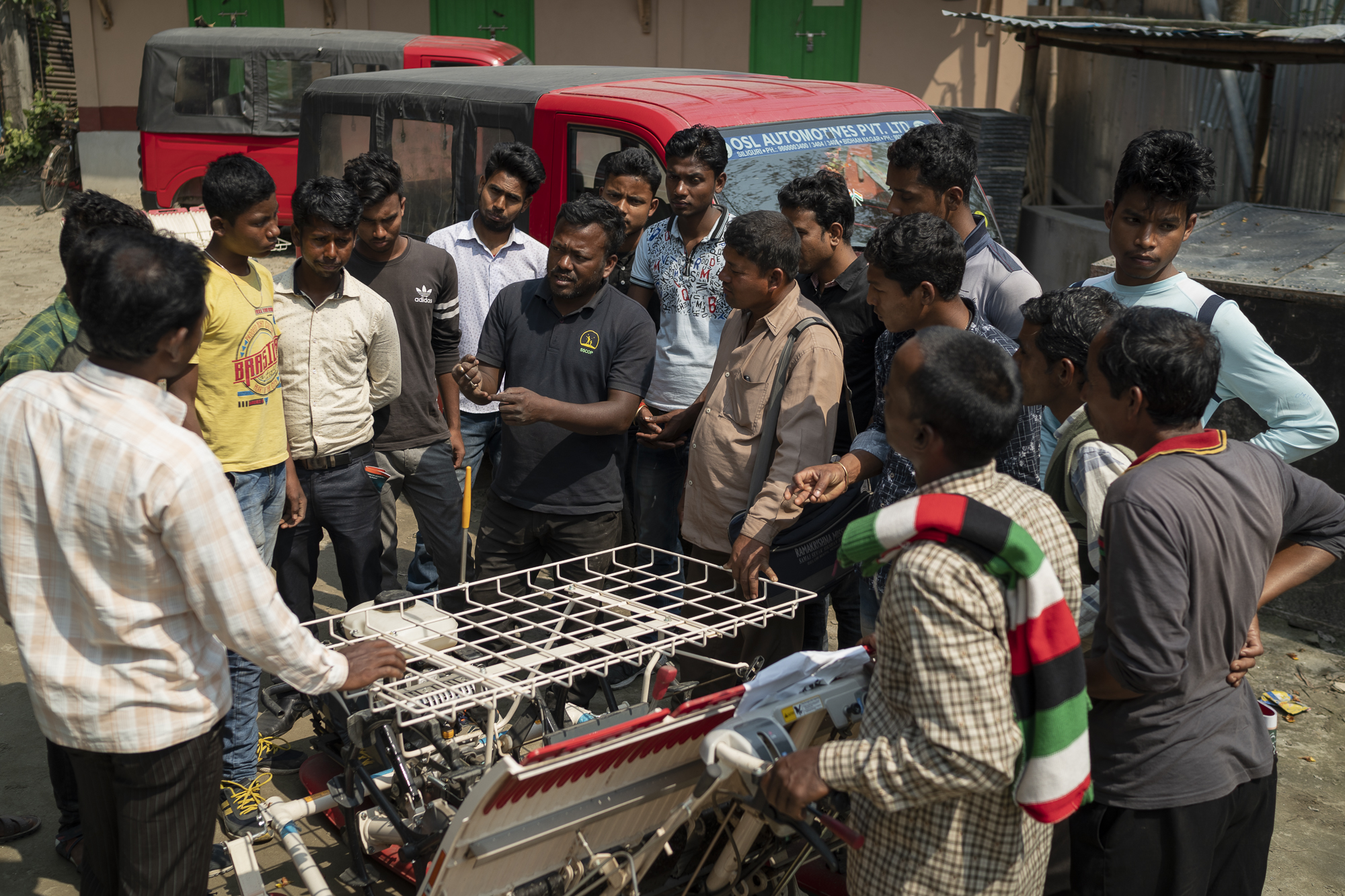 Staff from Satmile Satish Club share information with farmers and machine operators interested in using a mechanical rice transplanter as part of their machinery portfolio.