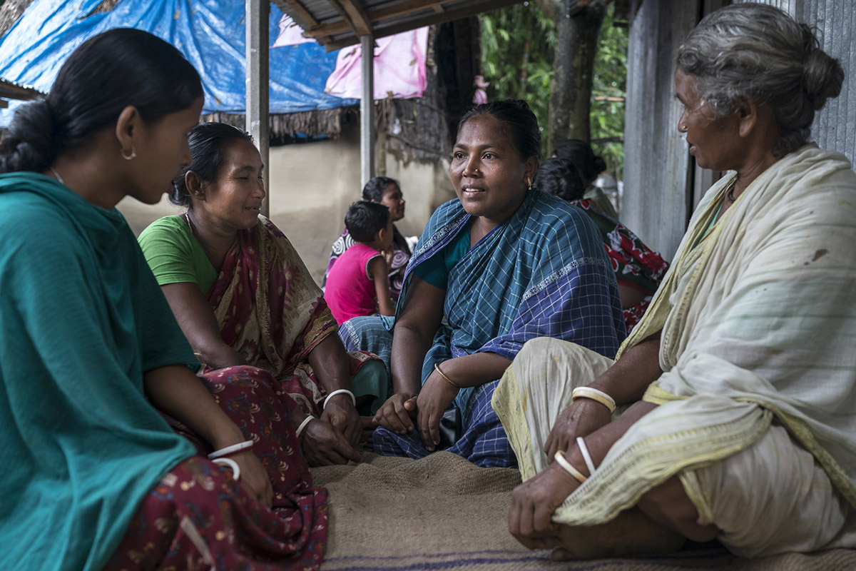 Kalpana sits and talks with a group of fellow female farmers from her village in Bangladesh. As part of SRFSI, women have been actively engaged in learning about and also adopting new CASI farming practices.