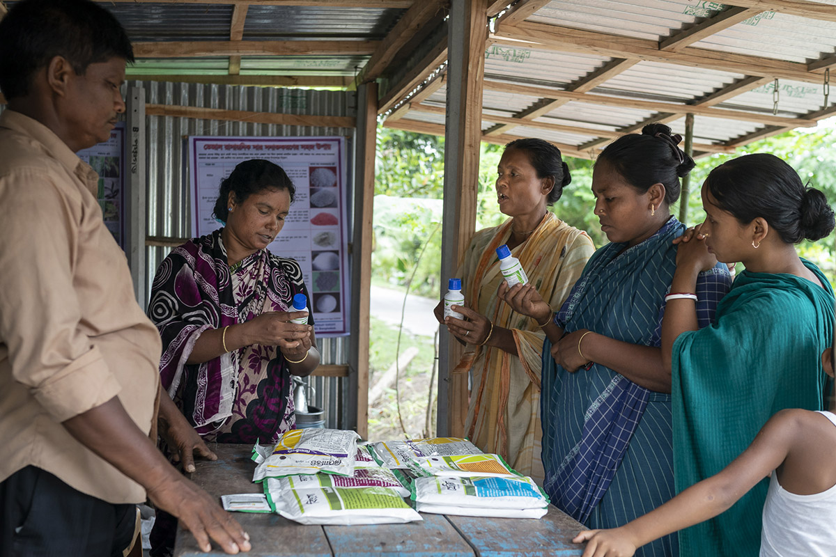 Robi Mardi and wife Pranati Murman talk to local farmers about a range of the agri-input supplies their shop sells.