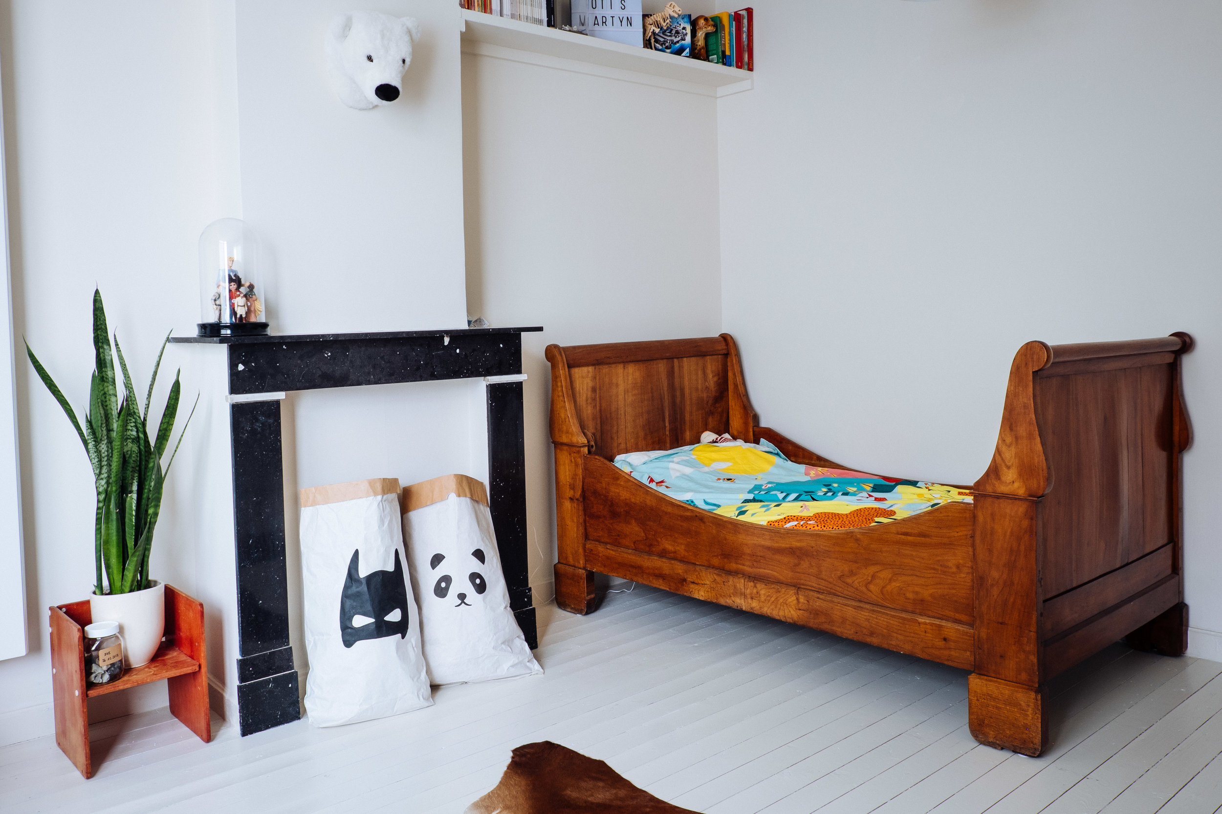 'A combination of heirlooms, treasuresand gifts' - Otis is already the fifth generation that sleeps in this wooden bed. It almost got ruined in the war, when they bombed the house!