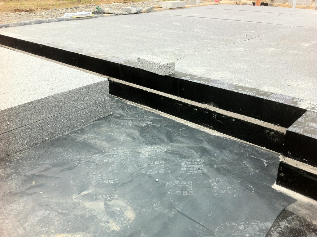 The photograph above illustrates the insulation being laid and fitted tightly to the Foamglas® Perinsul which has already been installed.