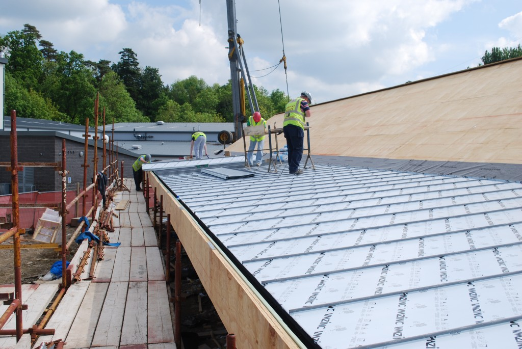 Zinc panels being clamped in place