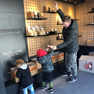 Sometimes it's all hands on deck - our kids helping Rich set up a store for Melbourne Cocoa
