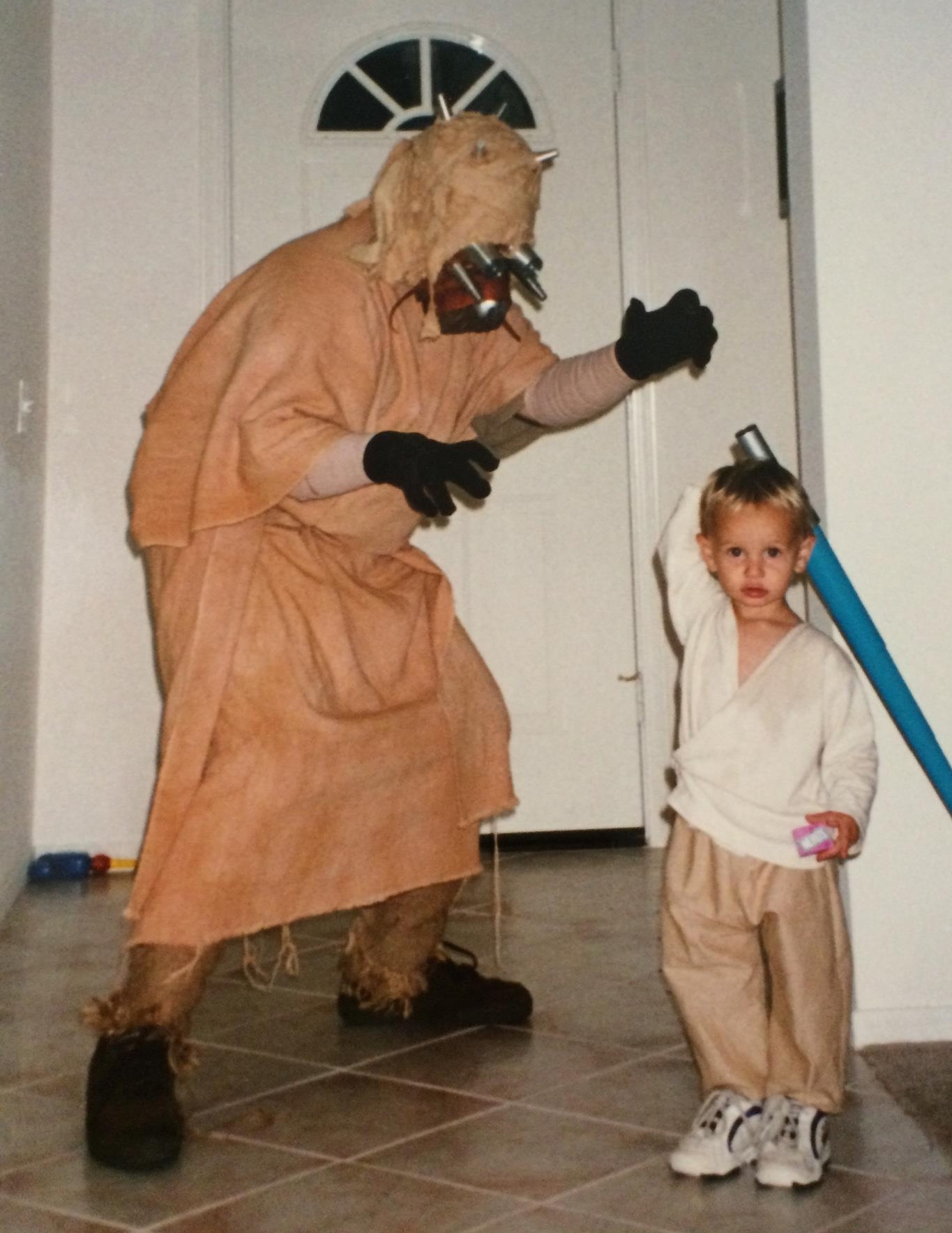 Me in my unfinished and kludged Tusken Raider costume. My son Austin in his custom made Luke Skywalker costume (minus the shoes, leg wraps, belt, macro binoculars and custom scaled lightsaber I built and he refused to wear, little bastard)