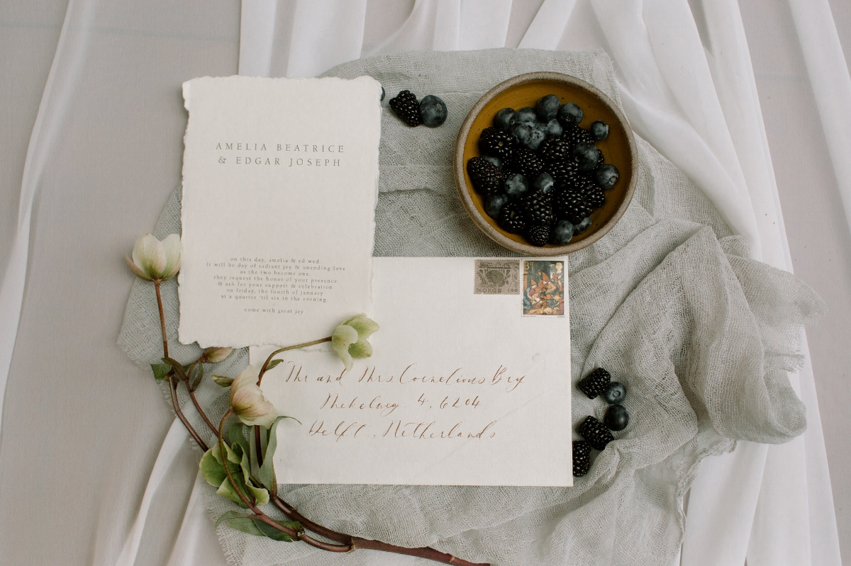 Custom Wedding calligraphy on soft white paper with vintage stamps