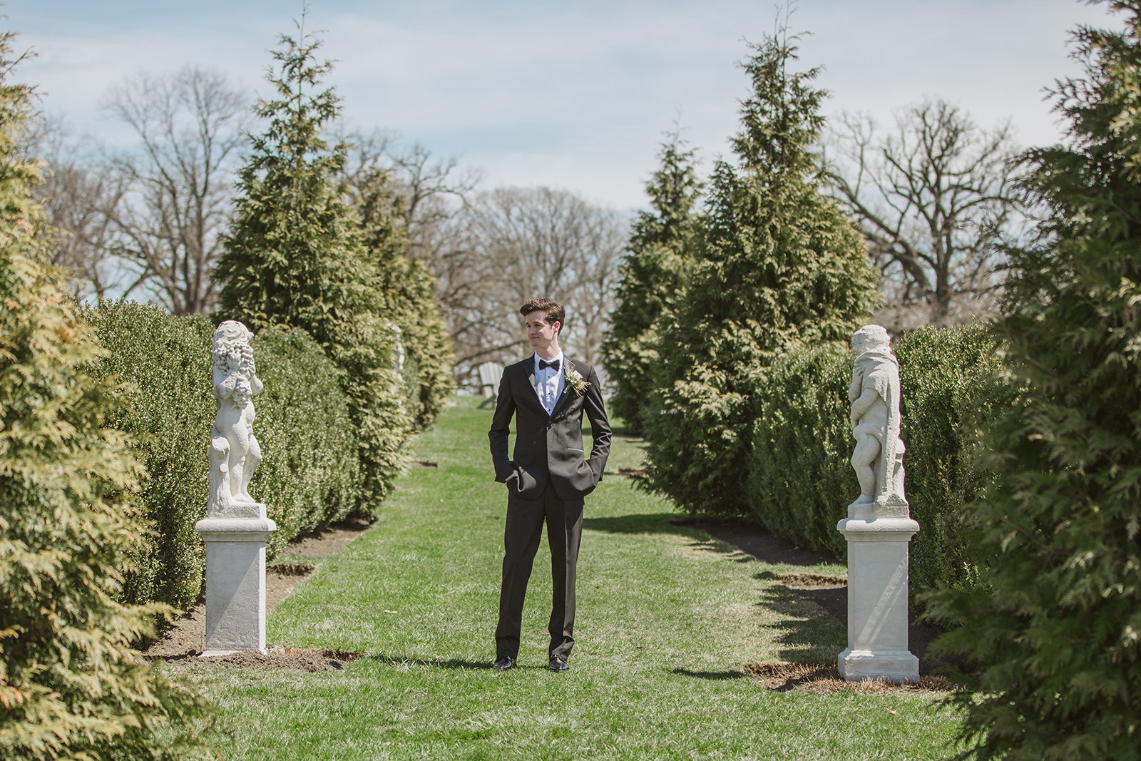 Groom in a slim black Tuxedo from Formally Modern Tuxedo at Elawa Farm in Lake Forest for a Chicago Spring Wedding