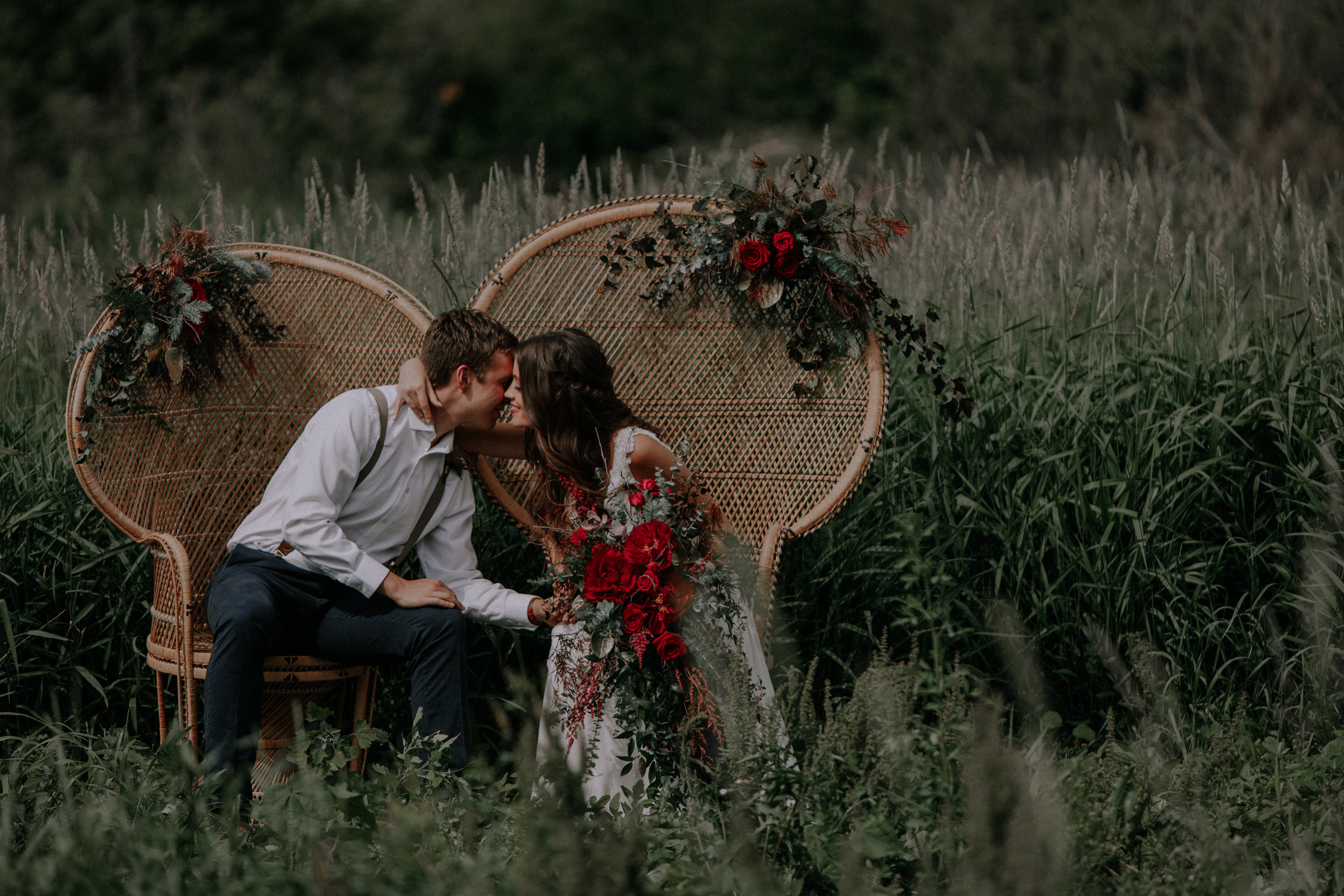 Wicker Chairs with Red Roses for Game of Thrones Wedding Elopement