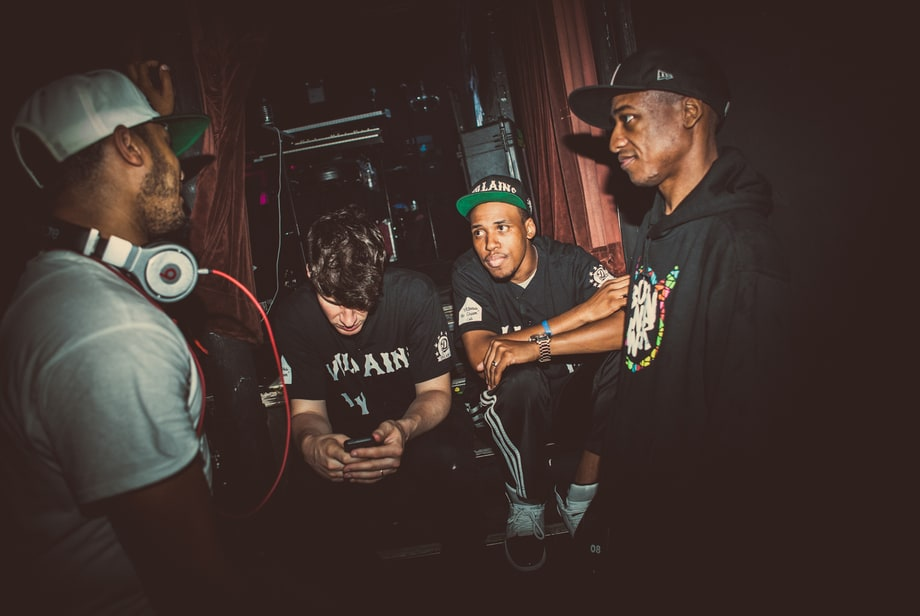 "Photo by Alex Pines.  ""DJ Dummy. Irvin Washington. Dave Linaburg. Ced. Almost show time.""   J. Cole's One-Dollar Show: Behind the Scenes in New York,  Rolling Stone"