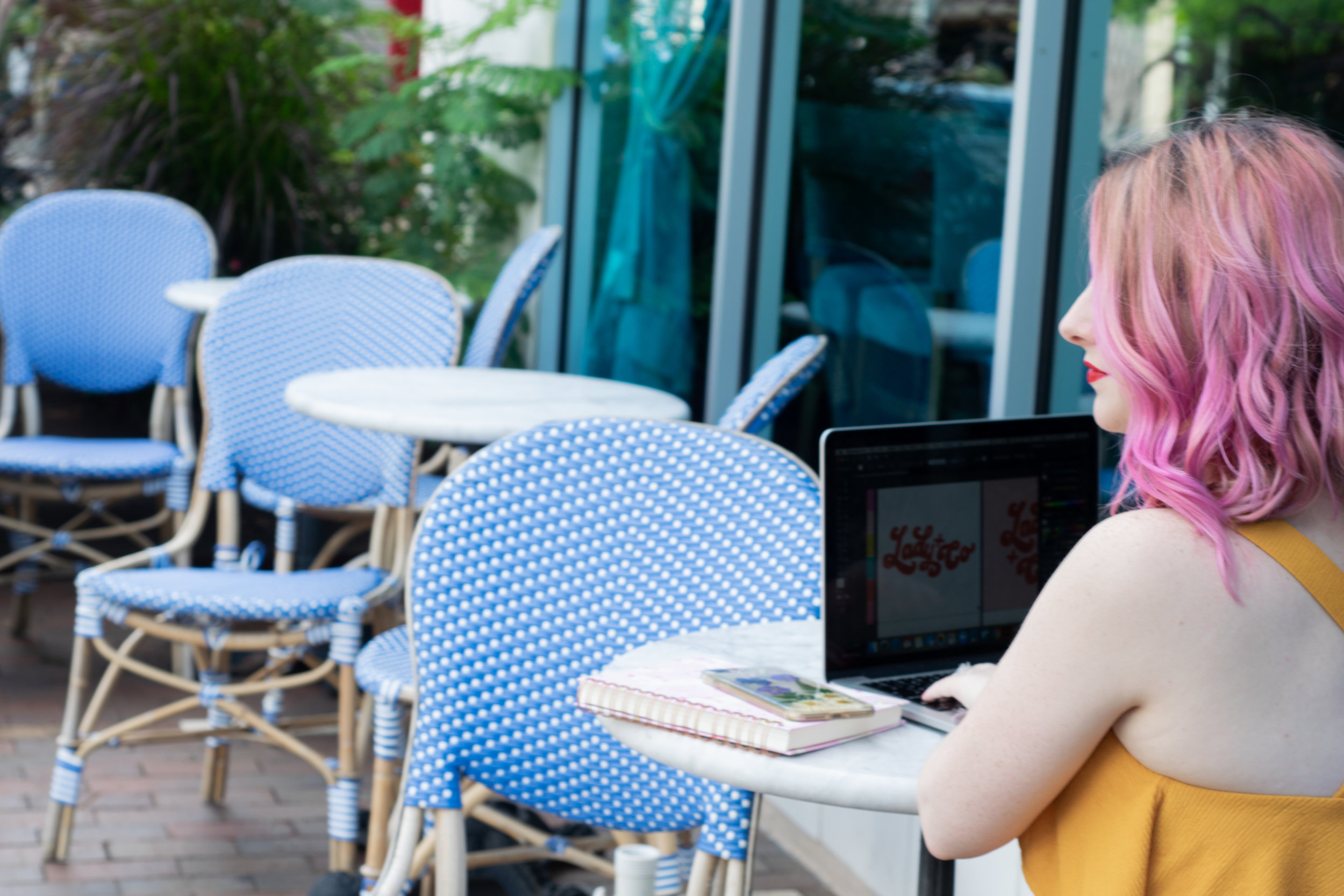 Lady and Company owner Alex Lawless sits in front of a computer at the restaurant