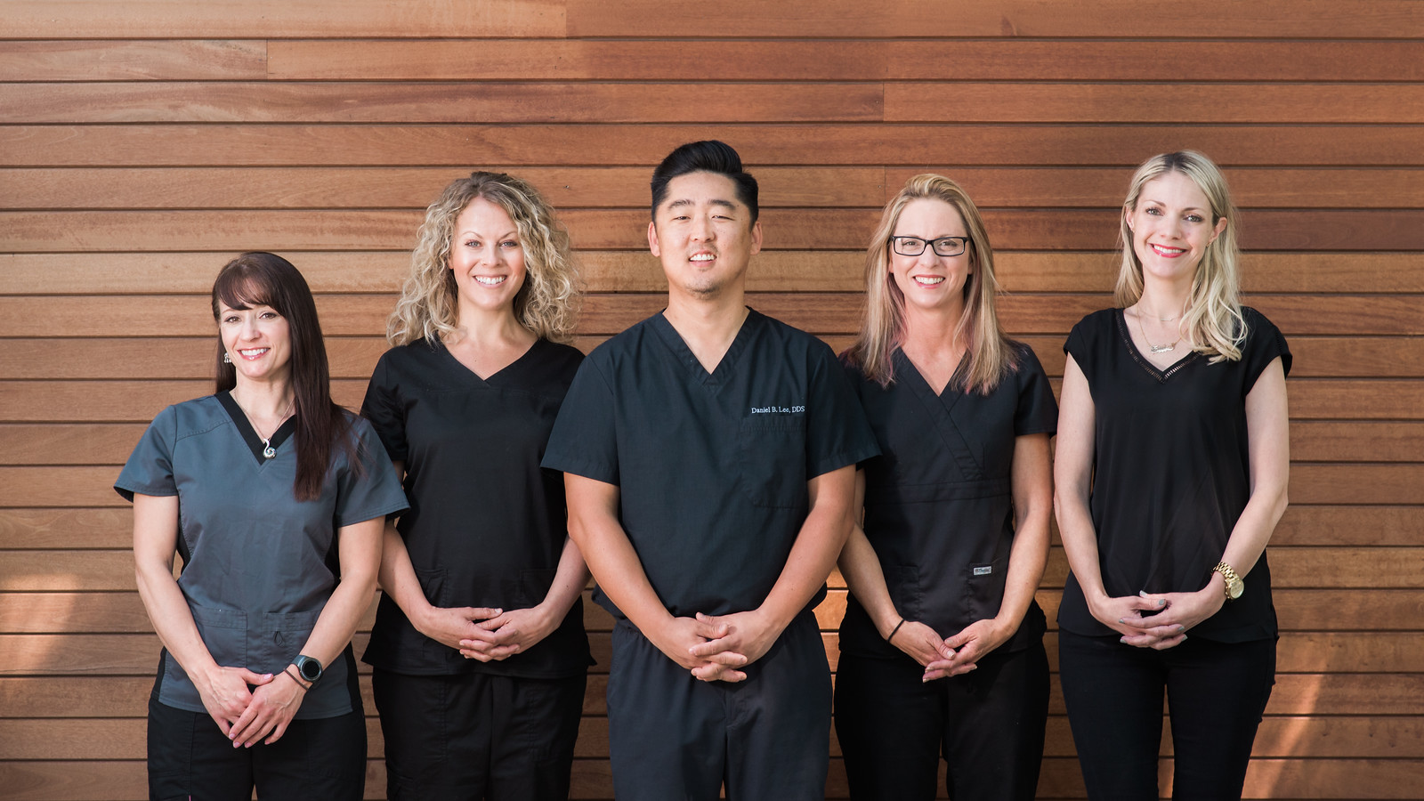 The East Burn Dentistry and Implants team with Dr. Daniel Lee in the middle.