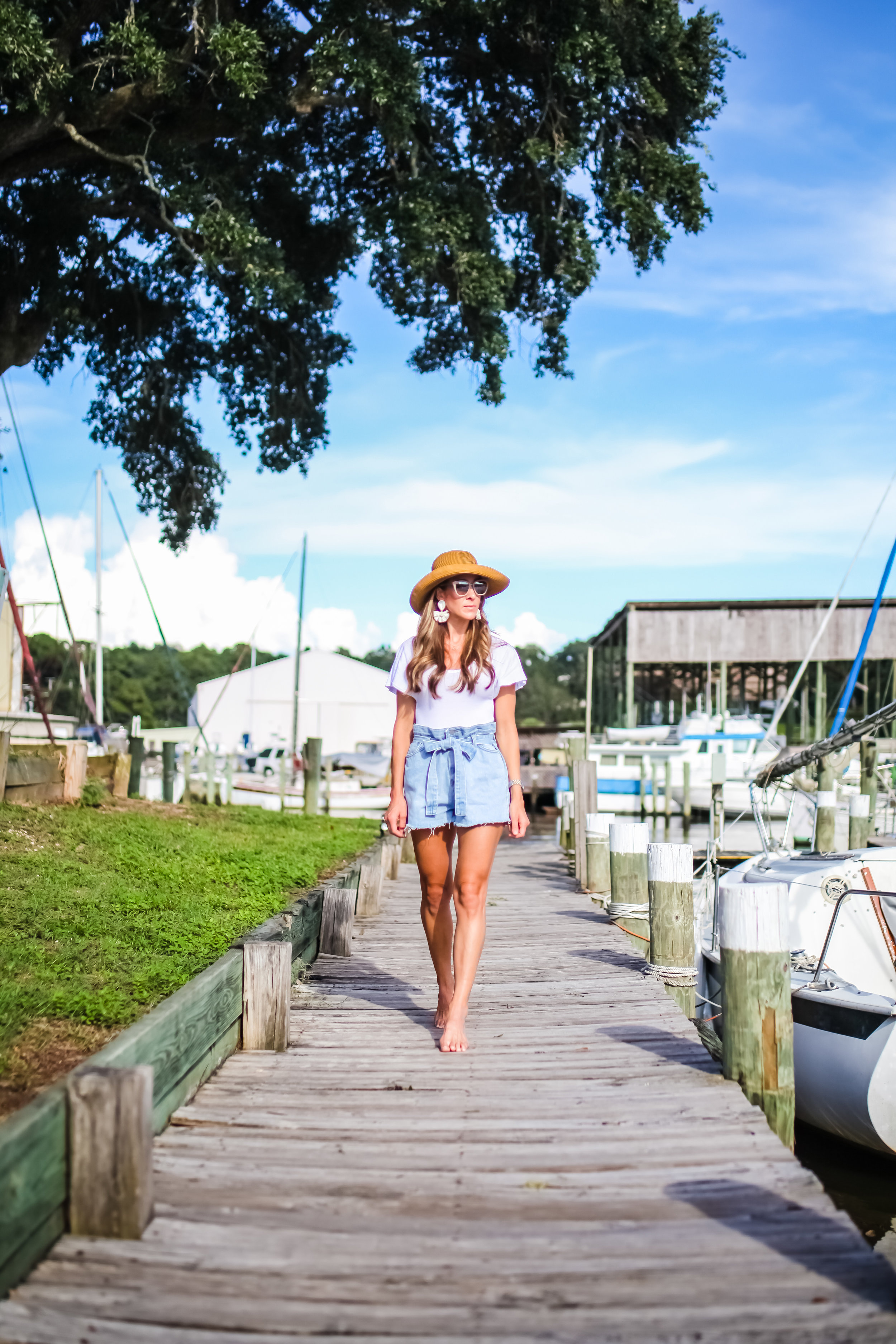 SHORTS - STORETS- ON SALE  HERE  | BODYSUIT - FREE PEOPLE - ON SALE  HERE  | EARRINGS -  SPROUTS DESIGNS  | SUNGLASSES -  JIMMY CHOO  | HAT - LOCALLY BOUGHT AT FAIRHOPE MERCANTILE - SIMILAR HERE | BLUSH - NARS COLOR IS DOLCE VITA | LIPSTICK - NARS