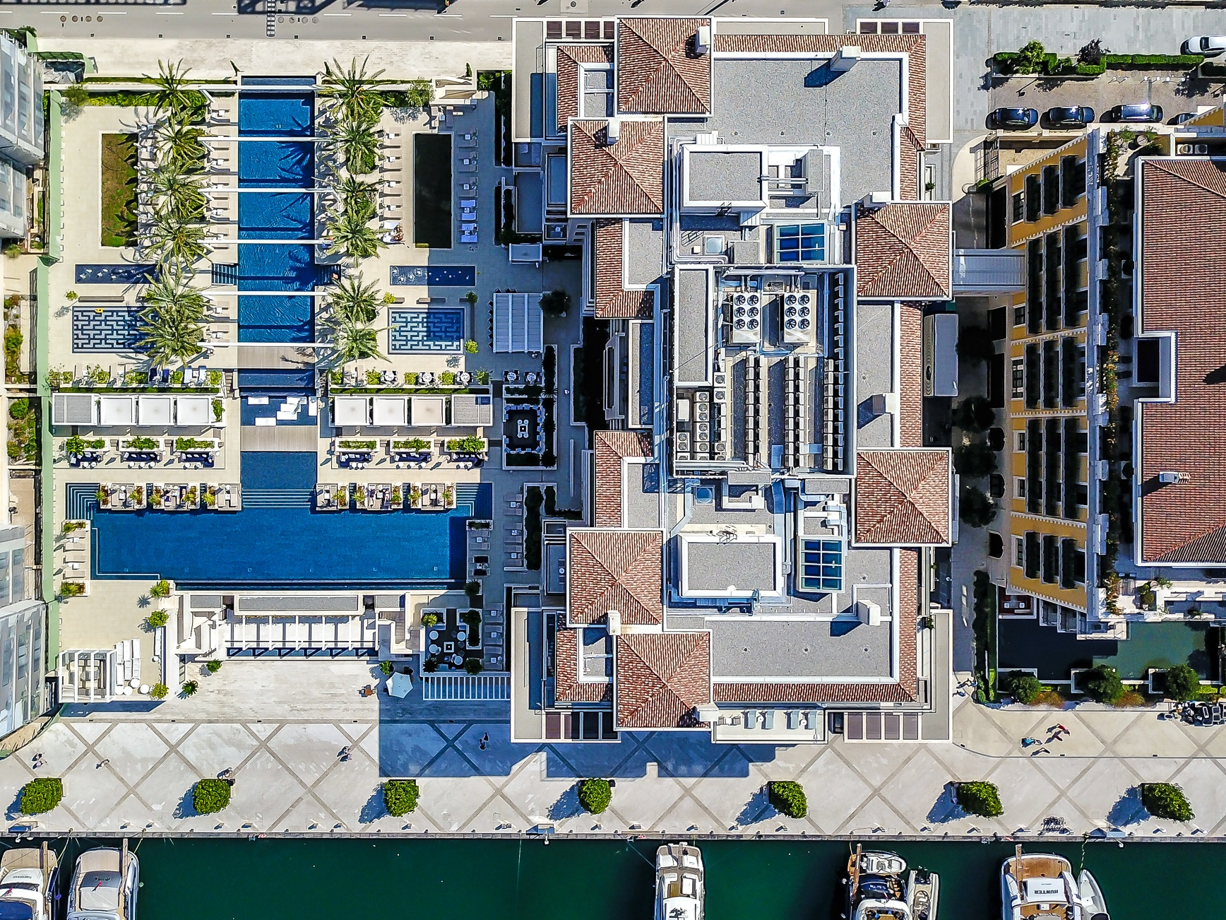 AERIAL VIEW OF THE POOL AND HOTEL REGENT PORTO MONTENEGRO