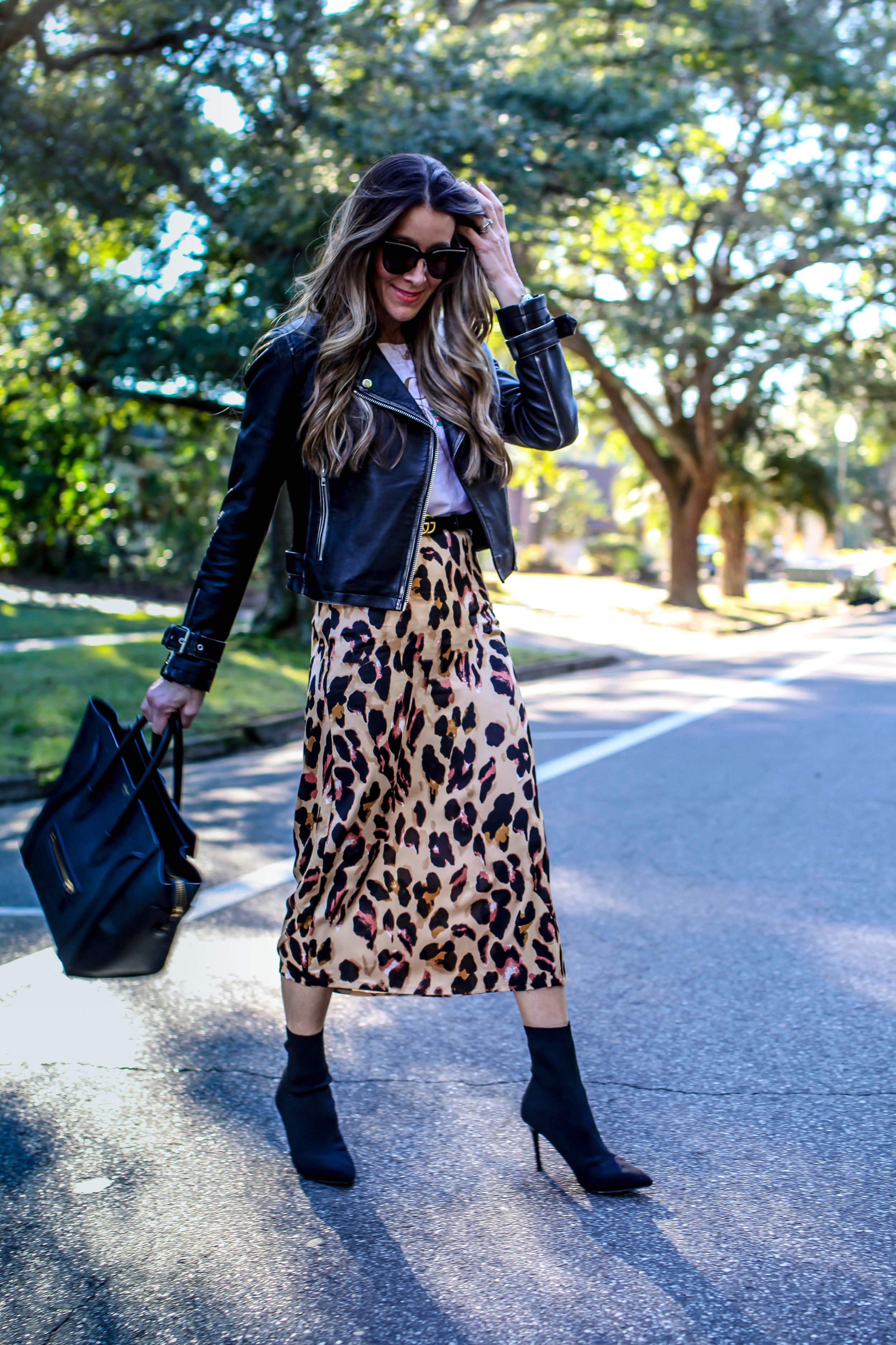 $16 AMAZON SKIRT -  LEOPARD  - OTHER COLORS  HERE  AND  HERE  | FAUX LEATHER JACKET - TOPSHOP - SIMILAR  HERE  AND  HERE  | GUCCI TEE - ORIGINAL  HERE  OR $13 DUPE VERSION  HERE  | HANDBAG - CELINE -  DUPE VERSION   HERE  | BOOTIES -  STEVE MADDEN  | SUNGLASSES - SIMILAR  HERE  | $6 DOLLAR NECKLACE SET -  HERE  AND  HERE