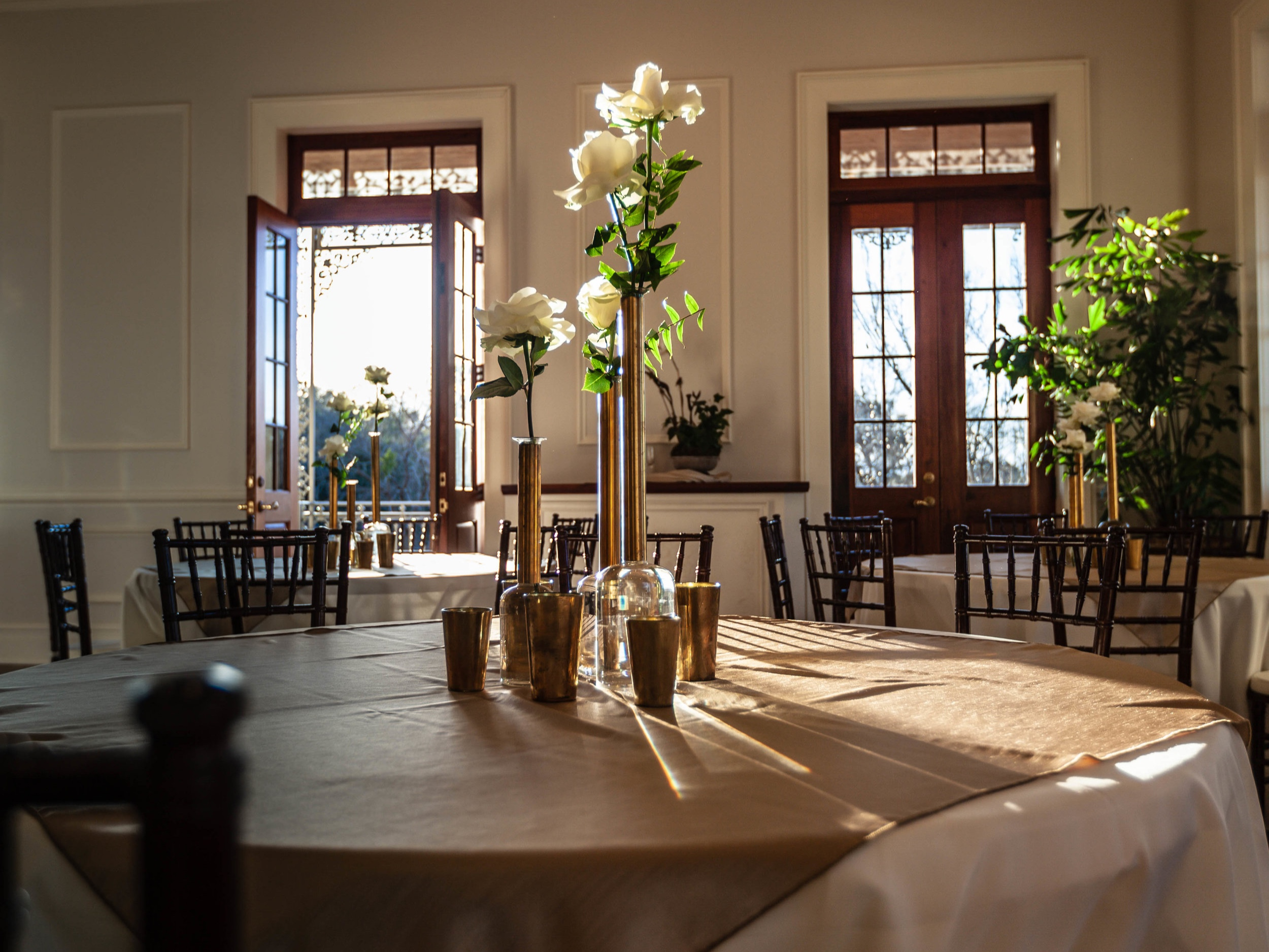 FLOWERS AND VASES FROM  WILDFLOWERS FAIRHOPE  AND ROOM AND TABLES STYLED BY CINDY BROWN WITH  ORGANIZE ETC .