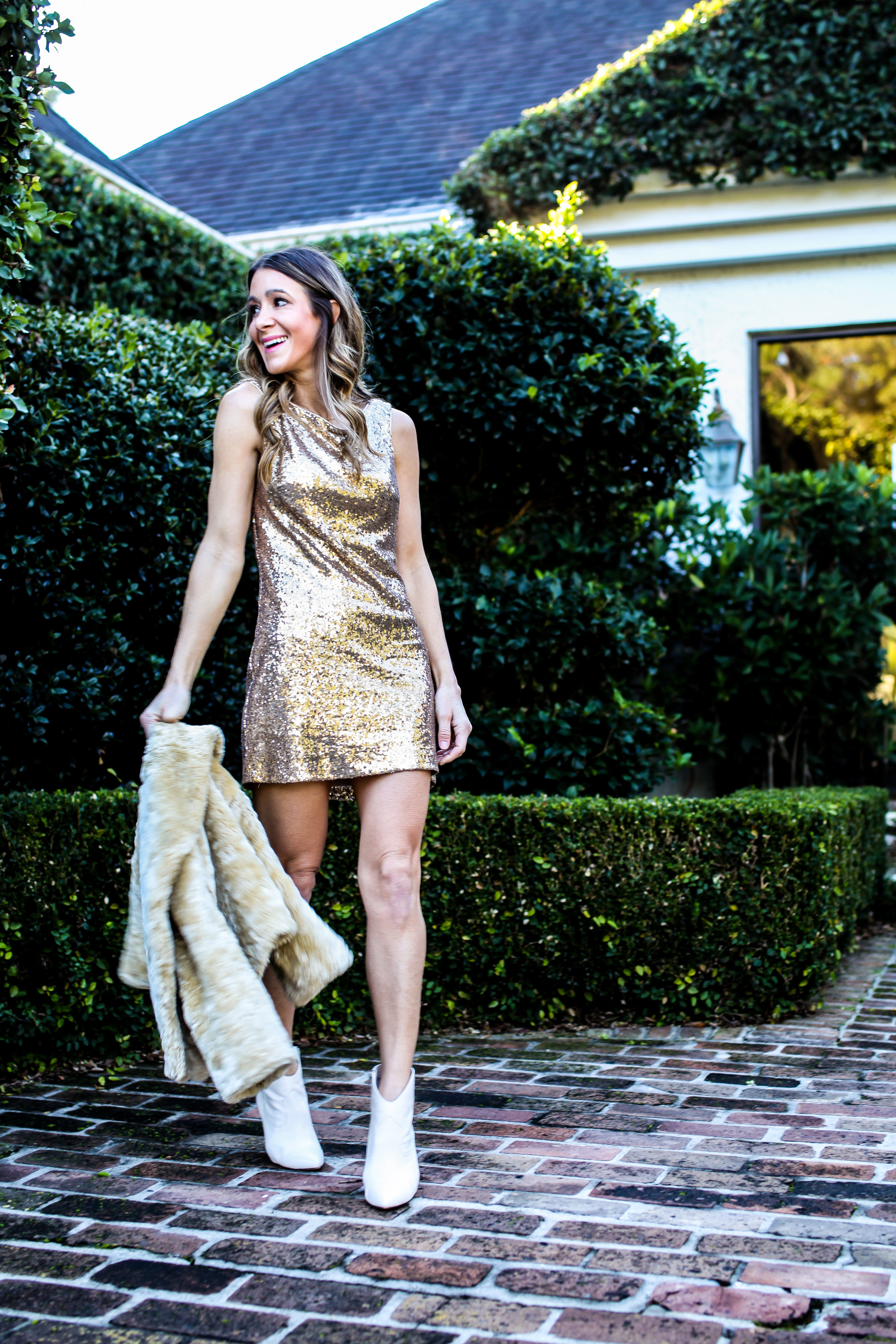 GOLD SEQUIN DRESS - JAY GODFREY  HERE  AND  HERE  | WHITE BOOTIES - VINCE CAMUTO - HERE - SIMILAR HERE | FAUX FUR JACKET - OLD - SIMILAR  HERE  | GOLD HEELS IN OTHER PICTURES - SAM EDELMAN -  HERE  |