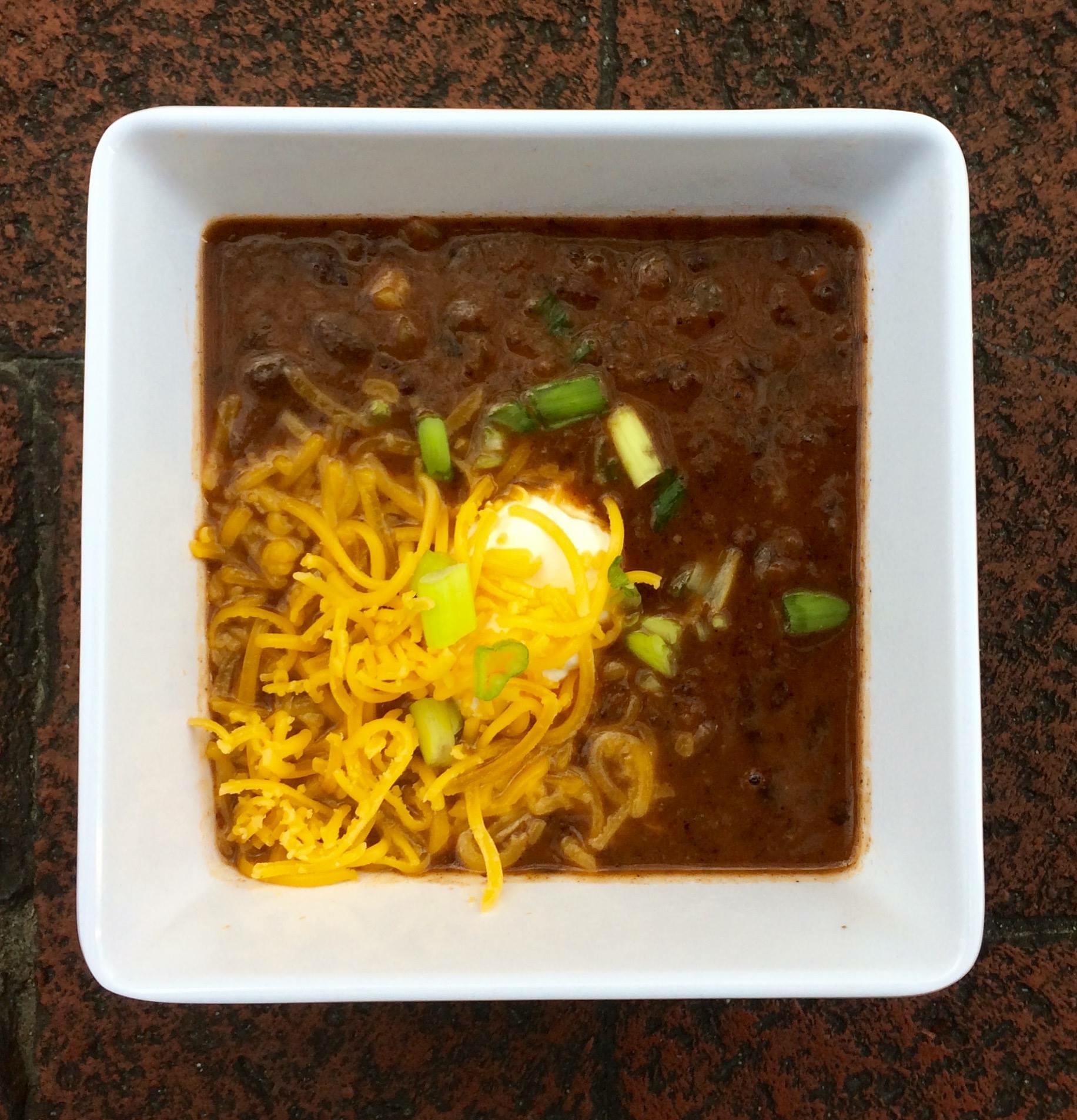 Vegan Black Bean Soup with Vegetarian Condiments: Sour Cream, Cheddar Cheese & Green Onion