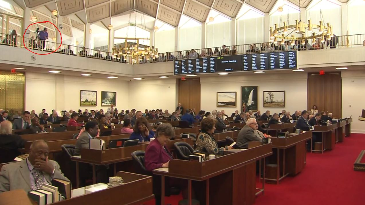 Gary and camera up in the gallery of the NC House chamber.JPG