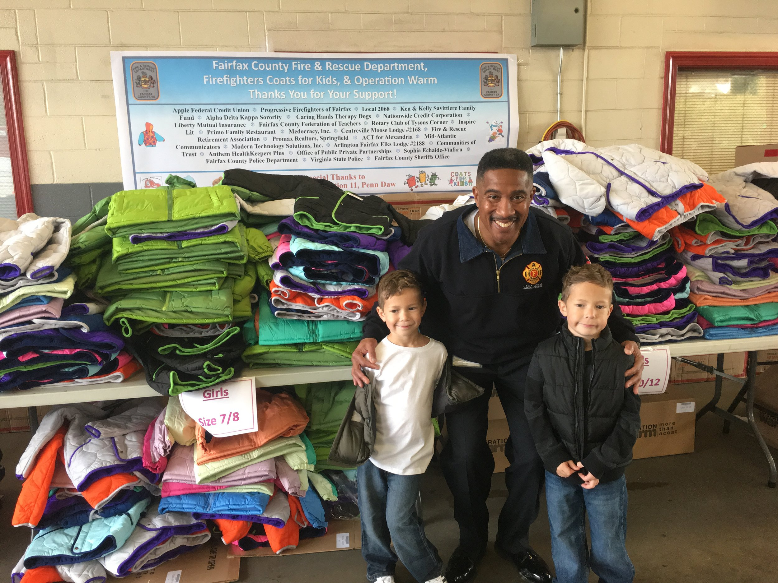 (Left to Right) Maks Savittiere, Chief Willie Bailey, Madden Savittiere at the Coat Drive Oct. 2016