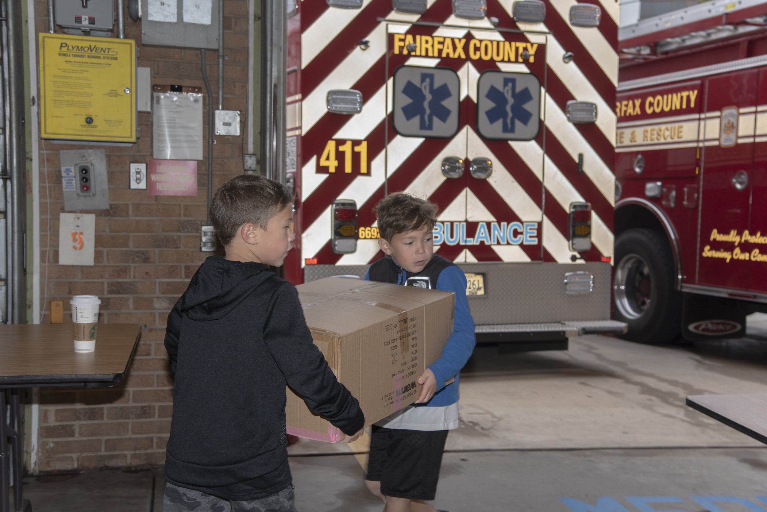 (Left to Right) Madden and Maks working together at the Coat Drive Oct. 2018