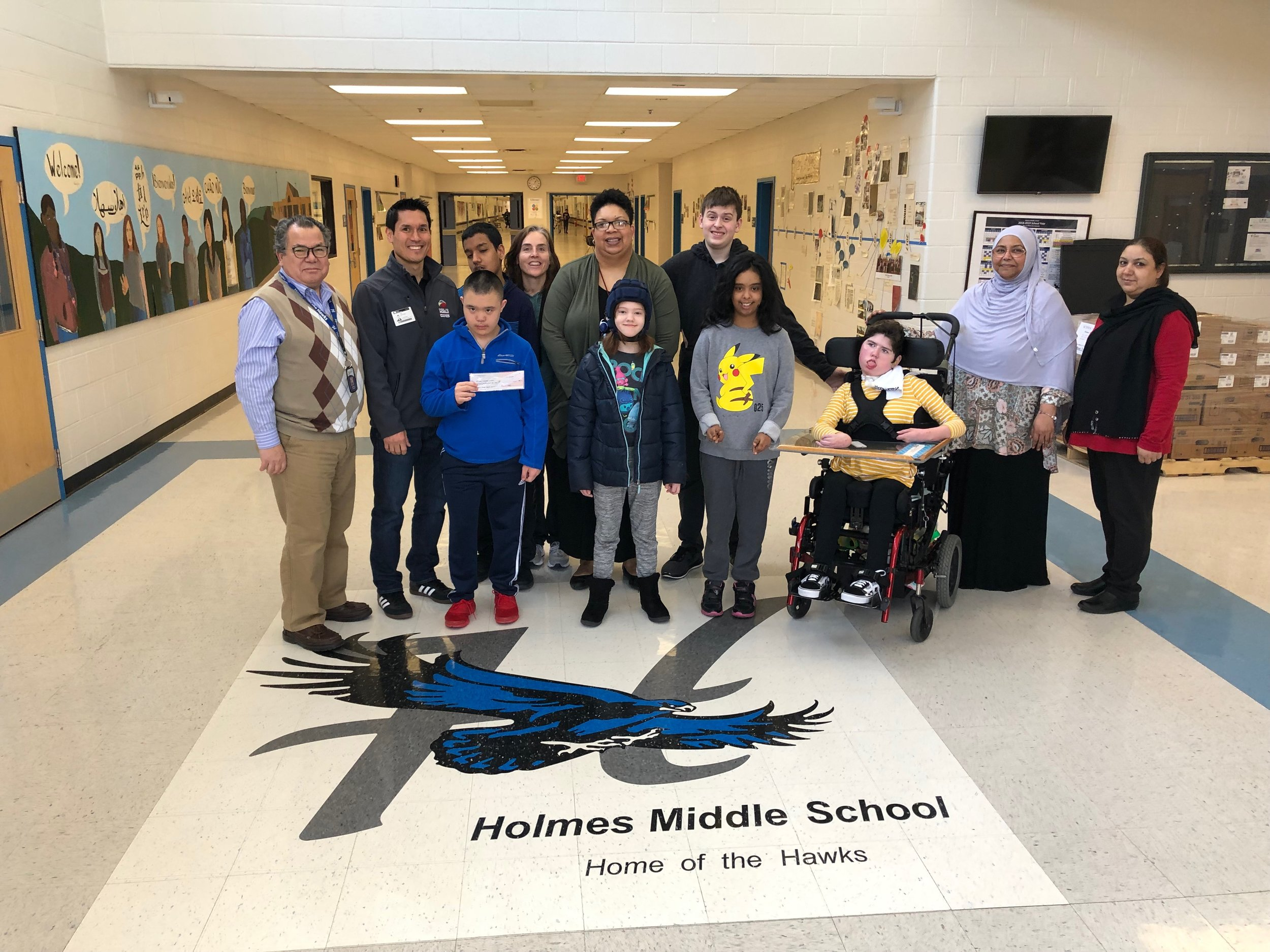 (Left to Right) Mr. Cabezas (After School Specialist), Ken Savittiere (K12AF & FCFRD), Mrs. Cheatham (PE/Adaptive), Mrs. Barnes (Principal), students and staff