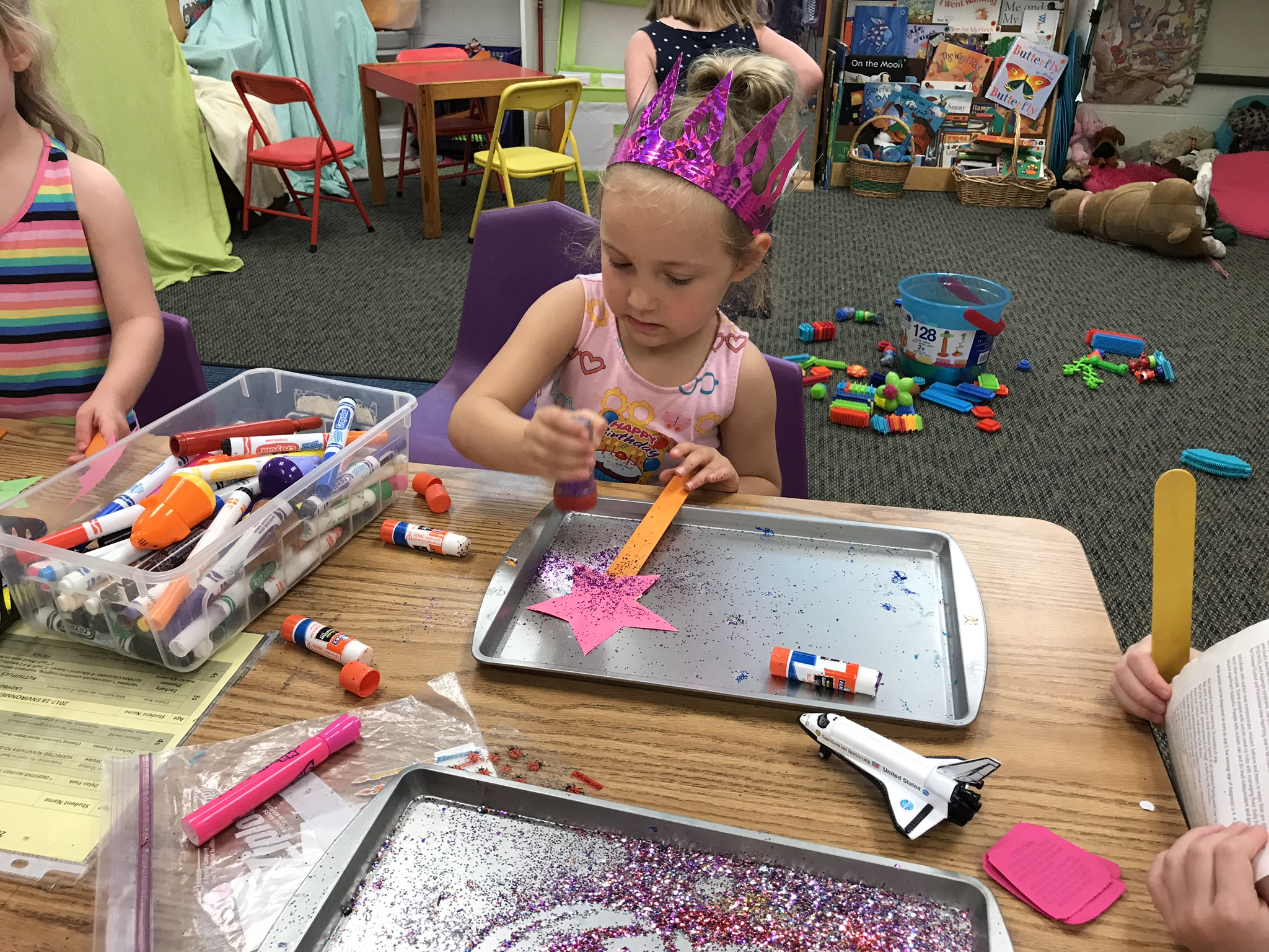 Spotlight Butterflies - Lets get messy! Art in all forms, paint, stickers, markers, dot-pens, glitter, glittler and more glitter... you name it and we will make art with it! The butterfly room is always a creative space for kids to explore their budding artistic side.