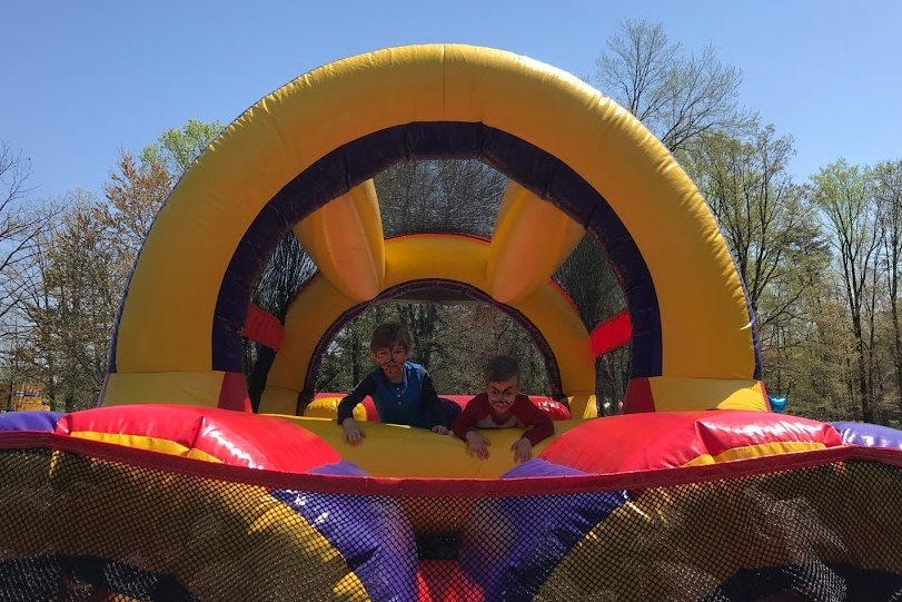 Family Fun Day - On Family Fun Day, families gather together to run and play in the spring sunshine!  We have obstacle courses, a bounce house, face painting and fire and tow trucks to explore!  We also have a good old fashioned bake sale and plenty of playground fun!