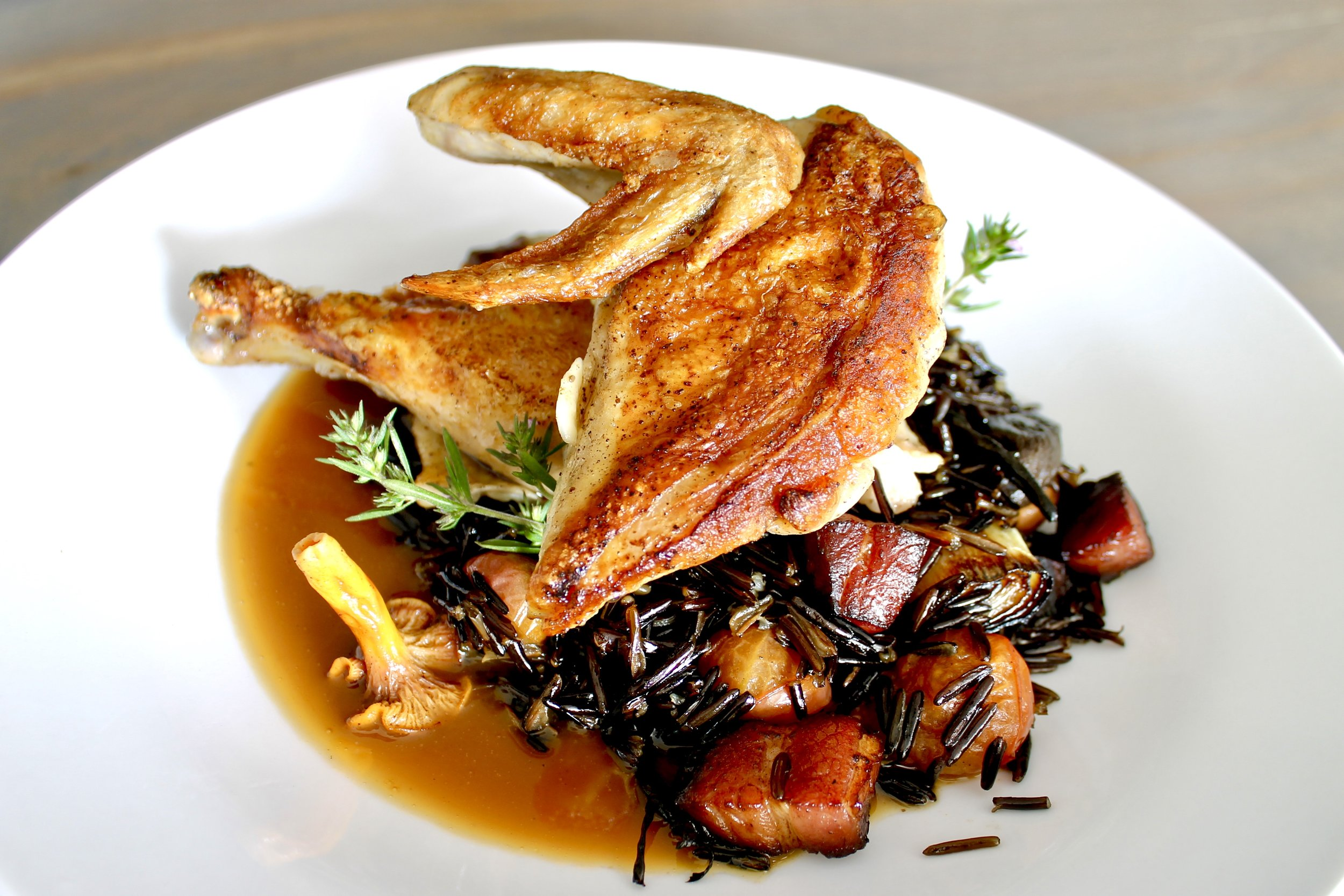 Cast Iron Chicken with Wild Rice, Bacon, and Chanterelles