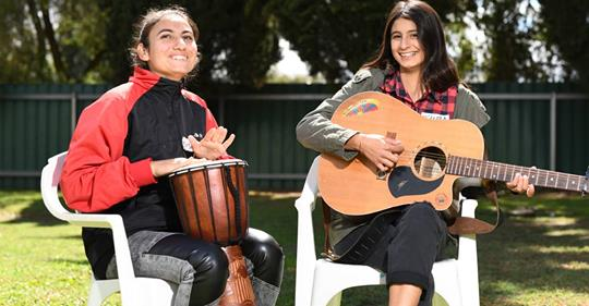 """ASSION FOR MUSIC: Maryam Sulaiman, 17, and Tuba Gundor, 16, earlier in 2019 where they celebrated nine months of Wagga Multicultural Council's mentoring program.  Cultural celebrations among the Riverina's young people are set to receive creative inspiration when a major arts project begins tomorrow. The 'No Borders In Our Sky' project is two days of music and art workshops for young people of various backgrounds. The program is a joint-initiative between Wagga Multicultural Council and Heaps Decent, an Australian-based arts organisation working with young people and emerging artists from diverse communities.  The organisation provides a means by which young people may tell their stories in their own ways. WMC community-development officer Thom Paton said the program is about """"celebrating cultures ... and for everyone to come together"""". """"Basically, it's a monthly program where Heaps Decent will come to Wagga to facilitate a range of different arts workshops,"""" Mr Paton said. """"It's a creative outlets for young people to explore their creative mediums — whether that be song writing or music.""""  The workshops will also have digital arts, including virtual- and augmented-reality technologies. While WMC and Heaps Decent have been working together for about eight years now, this is the first time this kind of project has been established. A number of musical and visual artists, along with two music producers, will attend, bringing a portable recording studio with them. The program will run on Monday and Tuesday, starting at 10.30am each day at 18 Station Place, Wagga.The initiative is funded through Multicultural NSW.  14 April 2019   https://www.dailyadvertiser.com.au/story/6043238/major-arts-project-to-help-young-people-celebrate-cultures/?cs=9402&fbclid=IwAR1iH1IChABS5mLpIZb11pcvt8VbjtvBgAYn5PqGmc0DrqcyXMlGW1ILFXk"""