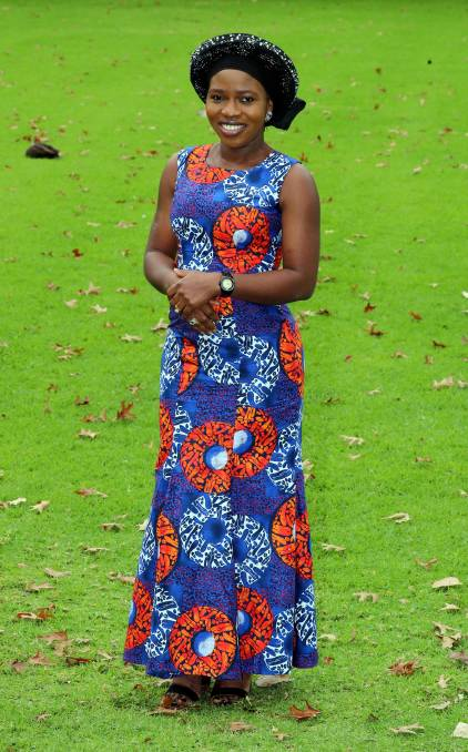 """Aderonke Ayedero, known to some as Elizabeth, moved to Wagga with her husband in 2017.""""I have been able to learn new things, meet new people and see what the culture is like here,"""" she said. """"It's very cold here.""""Ms Ayedero said she is proud of the country she was born in and all it has to offer. Nigeria is a country in West Africa which is rich in culture and diversity,"""" she said. """"We have three major ethnic groups in Nigeria, the Hausas, Igbos, and Yorubas and I am from the Yorubas. """"We have two main religions, Christianity and Islam so our country is very diverse which is a good thing.""""Ms Ayedero designs her own clothes and loves to choose bright colours to stand out.""""I am wearing an Ankara print and this [her headpiece] is called gele,"""" she said, """"I can wear this outfit to a wedding, a christening and I can wear it to any type of occasion.""""It is simple, we have the more complex ones but I like this one.""""    Ms Ayedero said in her culture, women do not show their hair so wear headpieces to cover it. """"This one is a design among the Yoruba people, the other ethnic groups have theirs as well,"""" she said. """"This one is the ceremonial one and we have one that we would wear day-to-day."""" Ms Ayedero adopts fashion styles and prints when designing and creating clothes for her online business. """"I make blouses with African prints so I can wear with jeans,"""" she said. """"I love colours and I love to play with colours so I like to wear the African prints all the time.""""This dress is not complex to make. I like white and red, so I look for prints that have a fusion of white and red."""" Ms Ayedero said it is important for her to showcase Nigerian fashion.""""I am proud of my culture and I want people to see what my culture is like,"""" she said.""""This is a way of me showcasing who I am to other people.""""Before I get to tell them who I am, they see it from what I am wearing.""""    For more information on Ms Ayedero's designs click    here   ."""