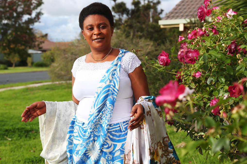 """PROUD OF BURUNDI: Izera Mazambo holds different styles of print that can be worn. She says for Burundians simple and natural is best when it comes to accessories. Picture: Emma Hillier    Simple, but beautiful is the way to go for women from Burundi. In recent weeks, The Daily Advertiser has been highlighting fashions from cultures that are thriving in the region, with women leading the way forward. Izera Mazambo fled her homeland after the Burundian Civil War, which was an armed conflict, broke out in 1993 and lasted until 2005. """"We came to Wagga because we were refugees in Zambia and there was a crisis in 1993 in my country so it caused us to leave,"""" she said. """"We lived in Zambia and after that, we applied to come here. We like Wagga because it is quiet and cool even though there are some challenges.""""    Mrs Mazambo said she misses the weather, the seasons are only wet or dry.""""You can dress up in whatever you want,"""" she said. """"I would love people to visit so they see mountains, valleys, animals."""" Mrs Mazambo said the traditional dress for women will vary depending on their age and formality of the occasion they are attending.""""They might dress in the same thing, but the way they wear it will be different,"""" she said. """"You have a separate top with a wraparound skirt. You have ones you wear at home and ones you wear to weddings.""""Mrs Mazambo is known for walking the streets proudly wearing her traditional clothes.""""For me, because I have girls, I want to maintain my culture so every Sunday and with every special occasion I put on my traditional dress,"""" she said. """"People know I wear them a lot.""""Mrs Mazambo said for Burundians simple and natural is best when it comes to accessories. """"We are not jewellery people,"""" she said.""""We are Pentecostal so they do not encourage jewels. """"We are here so we try them, but they like to be natural so we don't even put hair extensions in. You will see a lot of Burundians with short hair."""" When asked why it was so important to cherish and sh"""