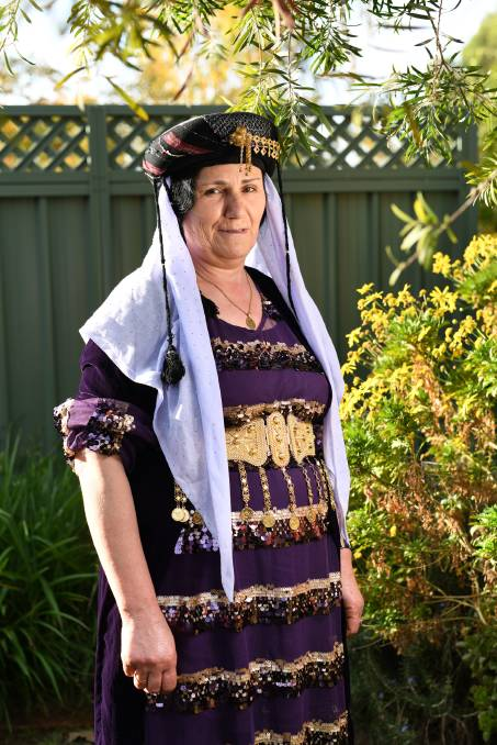"""SHOWING HER HERITAGE: Farzo Saleem is proud to wear the traditional dress of the Yazidi religion. Ms Saleem arrived in Wagga in August 2016 after fleeing Iraq.    Being able to freely express who she is without fear of retribution is a right that one Yazidi woman does not take for granted.    In recent weeks, The Daily Advertiser has been highlighting fashions from cultures that are thriving in the region, with women leading the way forward.    Farzo Saleem arrived in Wagga in August 2016 after fleeing Iraq due to the persecution and genocide of her people at the hands of ISIS.    """"Before we came to Australia we lived in Turkey for two years because our country wasn't safe,"""" she said.    """"ISIS attacked in 2014 and we left. In Turkey, we heard Australia was taking refugees so we applied for the immigration visa so we were one of the lucky people to come to Australia.""""    Ms Saleem said being Yazidi provides both a cultural and religious basis to who she is.    """"The best thing is our religion is for us,"""" she said. """"We don't have the concept of forcing others to be like us.    """"We just want a safe place to live happily with our families.""""    The Yazidi traditional outfit for women is a floor-length dress with a belt cinching the waist.    Ms Saleem said the gown is often accented by different jewellery and embellishments depending on the personal taste of whoever is wearing it.    """"We wear them for celebrations, weddings, Eid,"""" she said.    """"We buy the fabrics from the shops and then we make these dresses ourselves.    """"The belt and the jewellery are to add a beautiful look to the clothes.""""    For everyday clothing, the women wear simple dresses or whatever they are comfortable in.    Ms Saleem said there are no rules when it comes to casual clothing, especially since moving to Australia.    Red is often worn to symbolise the New Year and white is worn by the bride at weddings, such as in many cultures.    """"We wear all the colours depending on what you like wearing,"""" M"""