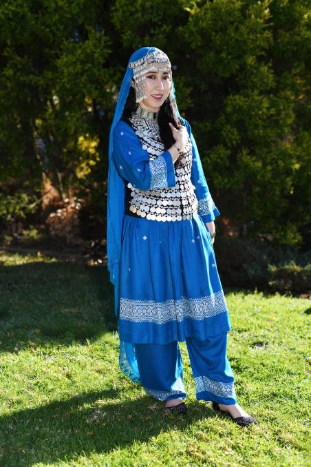 """Ms Ali said, for the most part, an outfit comprises of trousers, a dress and a scarf. """"We wear the scarf because Afghanistan is an Islamic country and all Afghani wear the scarf in a different way,"""" she said. The outfit in the picture is typically worn for special occasions, such as weddings, and includes a vest which has been hand-stitched with coins.    """"It is sewn on one-by-one by the family, the grandmothers and the mothers will sit together and help,"""" Ms Ali said. """"Our local jewellers in the city will make the coins to order out of silver when the girl is ready to get married.""""It is common for the woman to wear it every day in the first year of marriage and then after that, or after she has babies, she will wear the more simple outfit.""""    The outfit showcases the traditional embroidery that comes from Kandahar and is known as the white-work embroidery. """"It is known as khamak and is made out in satin stitch on a cotton or white silk background,"""" Ms Ali said.The necklace, headpiece, and all other jewellery are made out of silver so that it is not too heavy to wear.    Ms Ali said when she goes to work she typically wears jeans or dresses or dresses with leggingsrather than the more traditional clothes.""""I still wear the scarf on my head,"""" she said """"I love people to see my culture and learn about it.""""Ms Ali's story completes the series  The Makeup of Wagga ."""