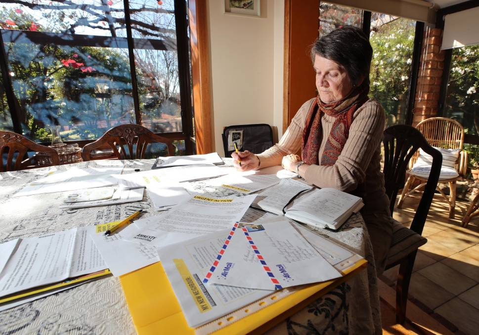 """To hand-write a letter, put it in an envelope and send it off at the post office takes commitment and time.  In a time of instant messaging and video calls, it's a little wonder that penmanship has become a lost art. But one group knows the power of the written word and uses it to their advantage in their call to action. Wagga Amnesty gathers once a month to write letters to politicians, embassies and organisations condemning the violation of human rights. Since February this year, the group has written 176 letters on 37 cases. In 2018 they wrote 293 letters and in 2017 they wrote 391 letters. Patricia Burgess has been a member of the group for more than six years. """"There is so much injustice around the world and I feel as though everyone has to do something about it,"""" she said.  """"Not everyone has to do this but everyone has to do something and I liked how Amnesty is global and non-political.""""They are working behind the scenes to deal with injustice around the world and there is plenty of it.""""Ms Burgess said she is horrified at how the Australian government has handled the refugee crisis, but there are also other issues she writes passionately about. """"It's the way women are treated in various countries, the US and their death penalty and there are plenty of issues around the world,"""" she said."""