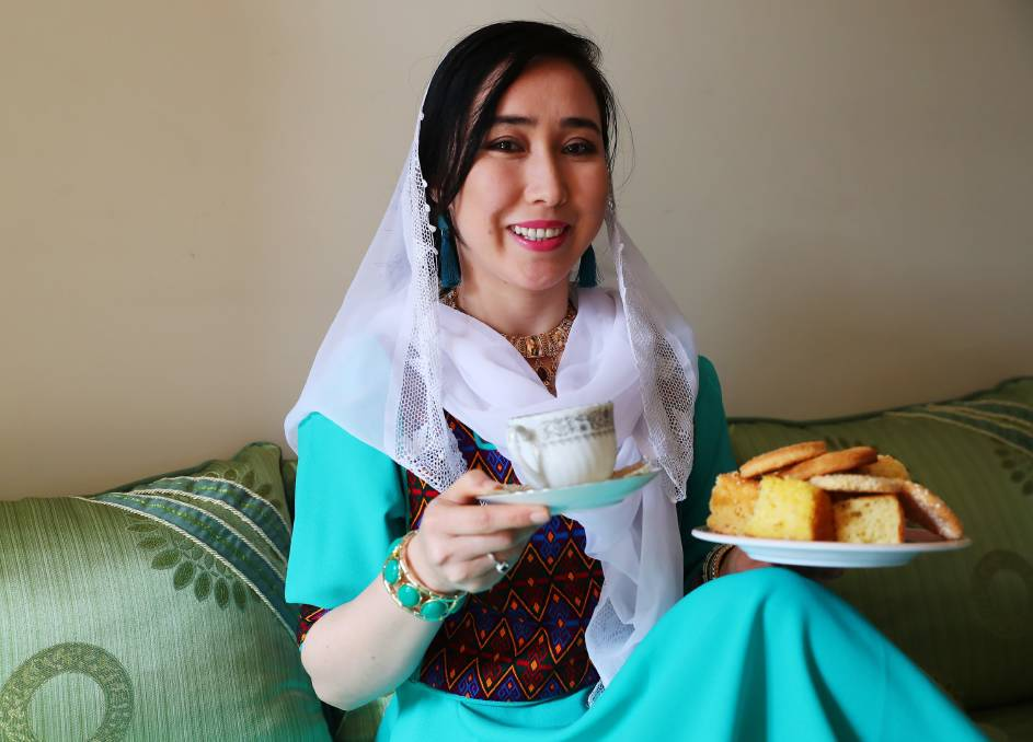 """Saira Ali made the dress she is wearing for the celebrations. Picture: Emma Hillier   With delicious food, lively music and dancing Wagga's Muslim population celebrated the biggest event on their calendar.    Eid al-Fitr is the feast that breaks the month-long fast of Ramadan and is celebrated over three days.    Saira Ali said the festival is a time to make amends, be generous towards friends and family and share values of peace and harmony.    """"This is a very important time for us,"""" she said.    """"It is very important for us to forgive those who we might be mad or upset at and we also pray for peace.    """"This is the biggest Eid.""""    Men will hug and shake each other's hands and women will do the same with each other.    There are multiple types of Eid, but this is the biggest one for the community.    Ms Ali said the first day is spent with close family, such as grandparents, and making new dresses. """"We also make Henna on our hands and we give gifts and happy wishes,"""" she said. """"We make many delicious sweets and food."""