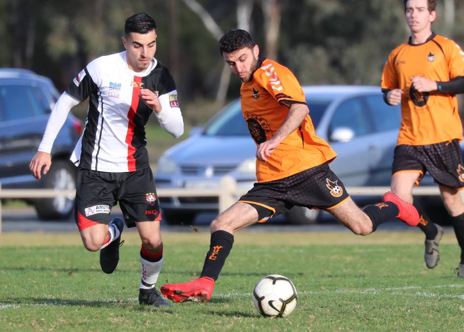 """DANGEROUS: Wagga United striker Nazar Yousif takes on Leeton United's Nick Trifogli during the Crows' 1-0 victory yesterday. Picture: Les Smith.   THE drama surrounding Fred and Henri Gardner has taken another twist, with the brothers in football no-man's land after failing to secure a release in time from Wagga City Wanderers to join Pascoe Cup outfit Wagga United. It means the Gardners, who parted ways with National Premier League club the Wanderers earlier this month, are unable to play anywhere for the rest of the season after the June 30 registration deadline expired.  It is understood a difference of opinion regarding registrations meant an agreement couldn't be reached by both parties. Wagga United coach Travis Weir said he's still confident his fourth-placed team can compete for silverware after grinding out a 1-0 win over Leeton United at Rawlings Park on Sunday. A booming strike from Tyler Allen ten yards outside the box just before half-time was enough to secure the three points. """"My understanding is they (Gardners) weren't released in time and we had a deadline we just couldn't achieve,"""" Weir said. """"The boys were pretty upset about it because they wanted to play and put in, but I've always been happy with my playing group. """"If we play like we did today and pick a similar team week in week out we'll see the results. """"We spoke about playing for the badge and for each other because it wasn't there at the start of the season, but there was plenty of heart in that today."""