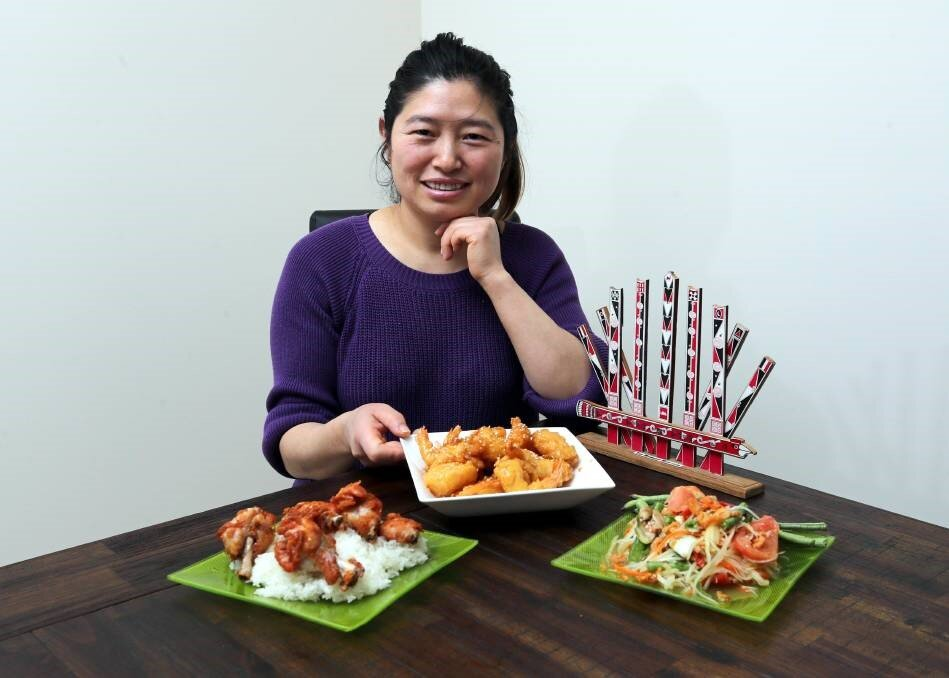 """CONNECTING WITH CULTURE: From fried chicken and sticky rice to pawpaw salad and honey prawns, Achin Mayit loves to cook. Picture: Les Smith   It's almost that time of year where residents and visitors can eat dishes from around the world to their heart's content. In the spirit of the upcoming Fusion Festival,  The Daily Advertiser  is profiling some of the delicious cuisines that can be found in this city, and the people who can cook them with their eyes closed.    Achin Mayit fled Burma - known to some as Myanmar - to escape the military government. """"I was then a refugee in India before the Australian government accepted me to come here,"""" she said."""