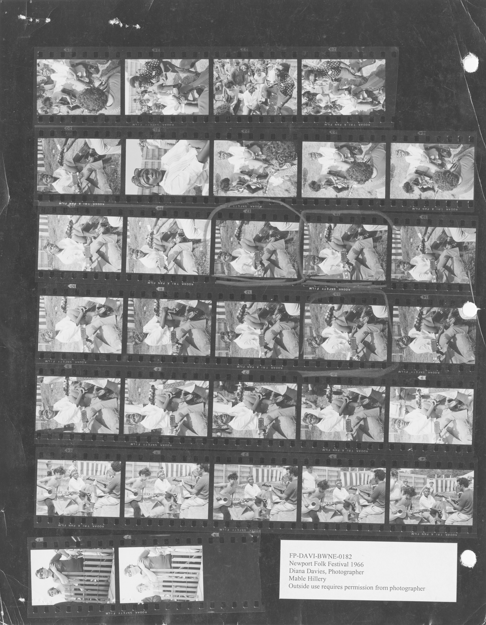 Mable Hillery turns up across several of Davies' Newport Folk Festival contact sheets. In 1964 and 1966, Hillery performed with the Georgia Sea Island Singers, while in these shots she is found in more informal circumstances around the festival grounds.