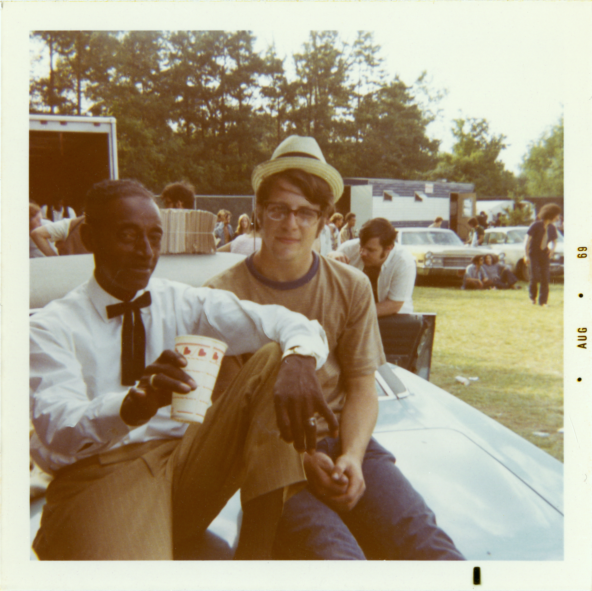Eighteen-year old Jim Fishel spends some time backstage with Mississippi Fred McDowell