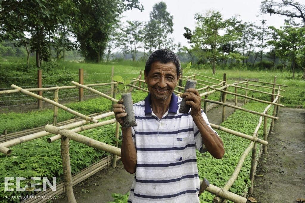 Nepal_2015_Man in nursery holding seedlings.jpg