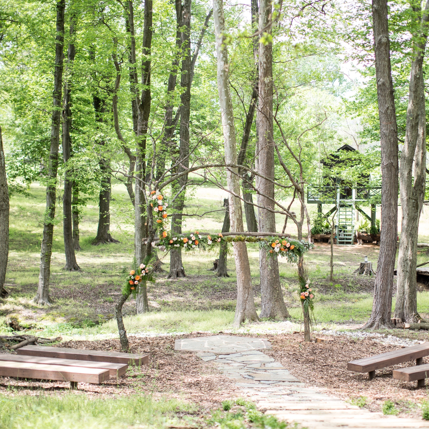 The Woodland - If you are looking for that one of a kind woodland ceremony location, look no further! We know that a woodland setting is hard to come by in this area. We have custom designed a woodland arch that is ready to be decorated to your hearts content. Guests may even witness a passing deer or two drinking from the nearby stream.Photo courtesy of Jalapeno Photography