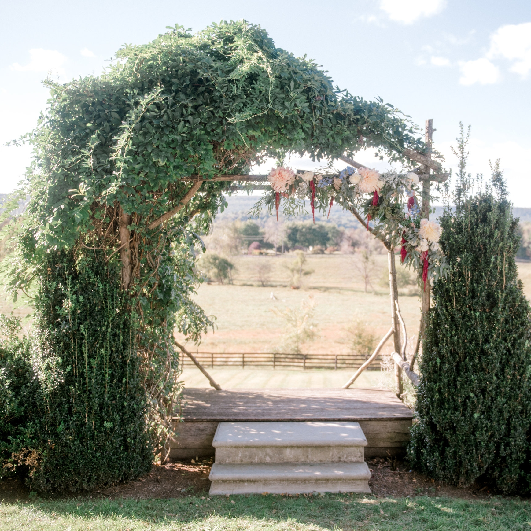 The Arbor - The most popular location to exchange vows at Silverbrook is at the arbor in the garden. Views of the farmland below and the Blue Ridge Mountains in the distance create a calming and peaceful setting. The arch is naturally decorated with vines, but couples can add their own florals and decor to make it their own. The raised platform under the arch provides the perfect view for your guests and they won't miss a thing as you say your