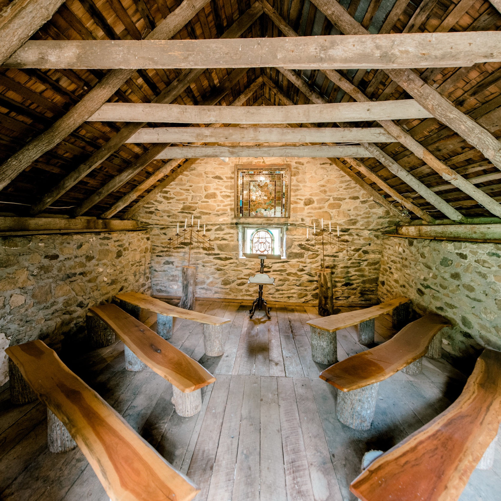 The Chapel - This small historic chapel on the property is perfect for more intimate ceremonies rain or shine. You will fall in love with the stained glass details, antique candelabras, and the hand hewn benches that serve as pews. This one of a kind chapel is sure to wow your guest and create a truly memorable ceremony experience. This is a wonderful option for those interested in a pop up wedding, or simply for photos!Photo courtesy of Photography Du Jour